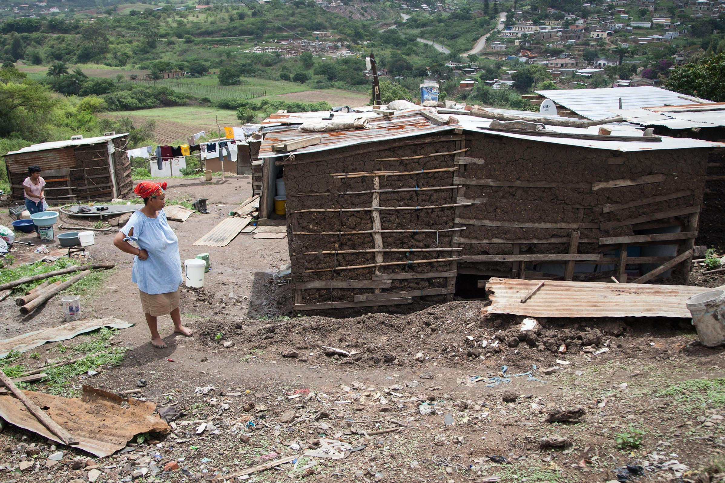16 November 2019: Sizeni Maphenduka assesses the damage heavy rain in Tommy Property shack settlement caused to her mud house.