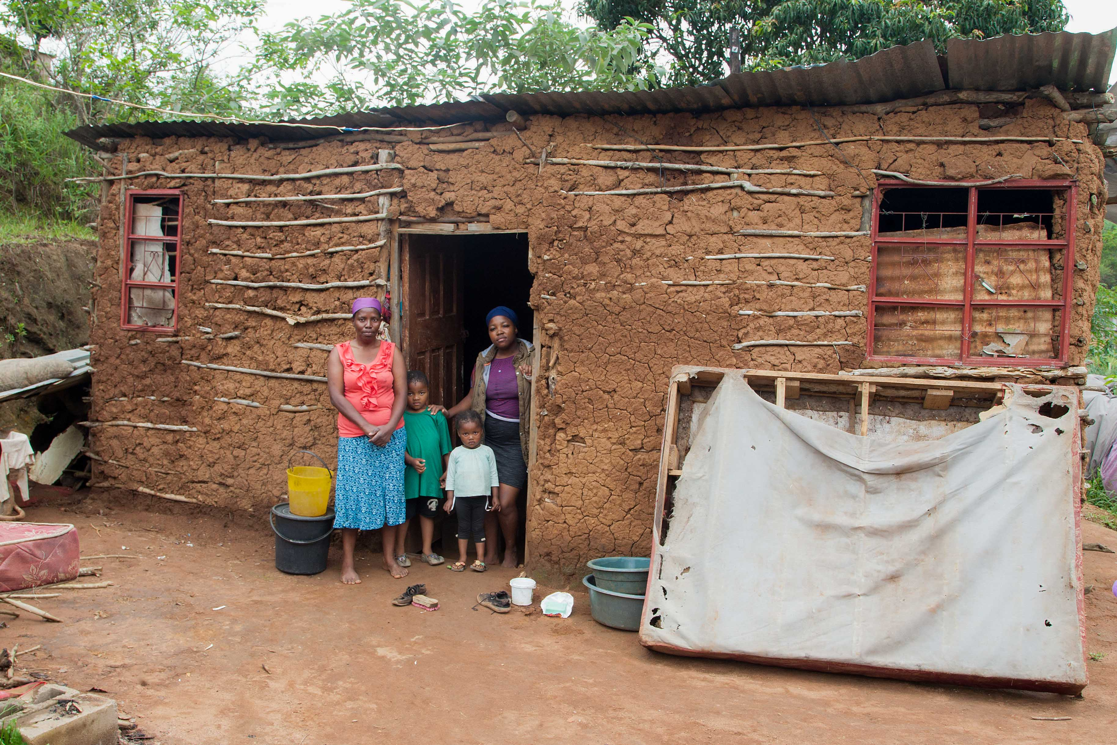 16 November 2019: Philisiwe Dube at home with her daughter, Londiwe, and grandchildren, Esihle and Enzokuhle. Their mud house in Ndwedwe, KwaZulu-Natal, is still waterlogged.