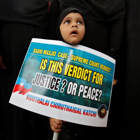 21 November 2019: A Muslim girl holding a placard looks on during a protest to condemn the Supreme Court of India's judgment on the disputed religious site in Ayodhya, Chennai. (Photograph by P Ravikumar/Reuters)