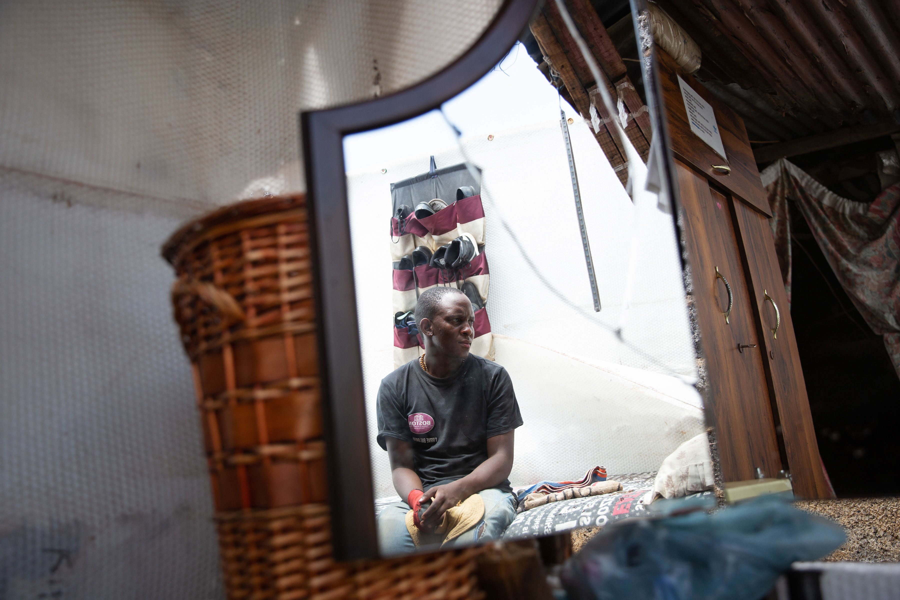 21 November 2019. Motshehwa Mmifi's son, Tshepo Mmifi, in his partially demolished room. The roof was removed and rain soaked his bed and clothes. His mirror was also broken.