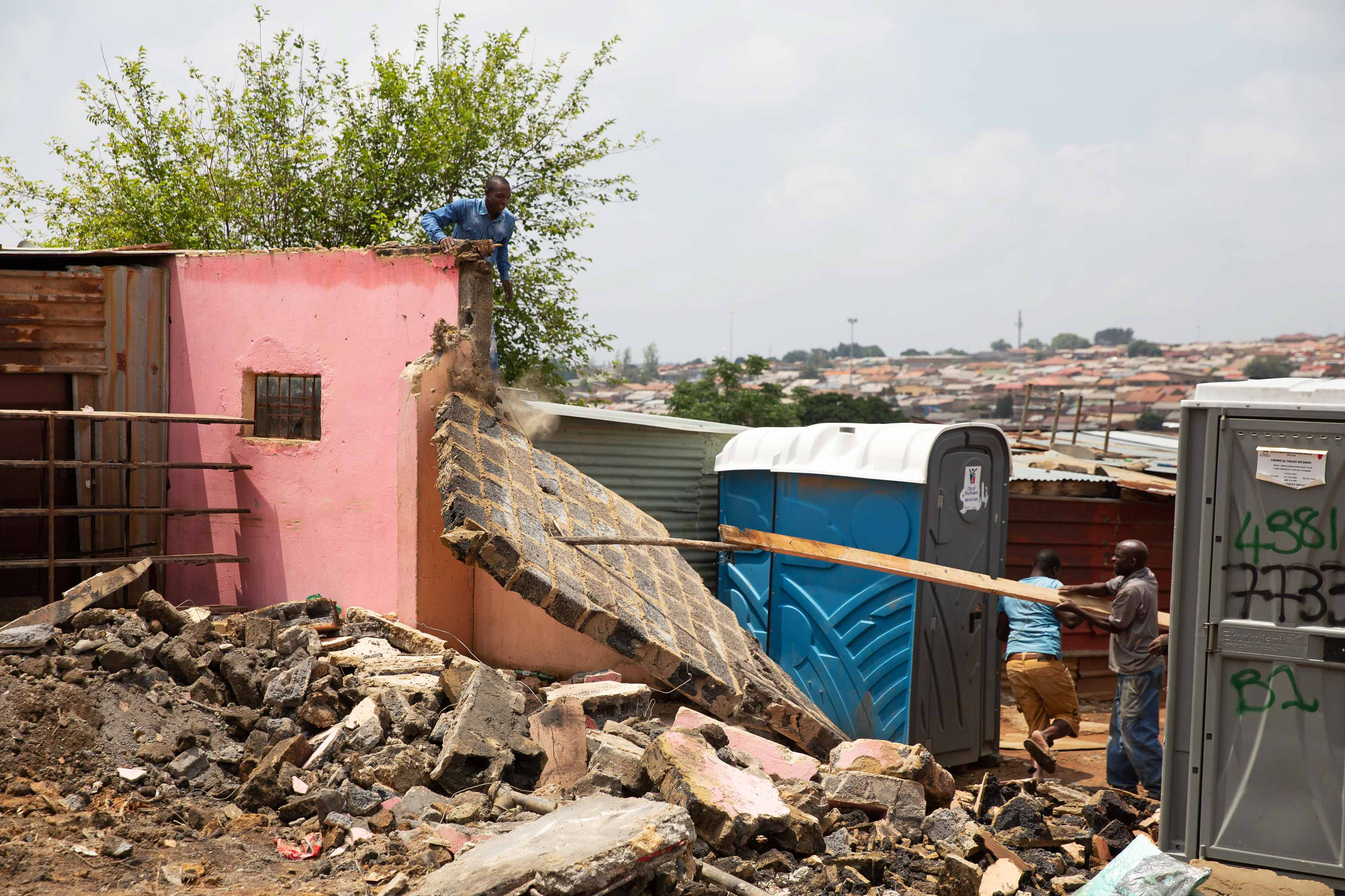 21 November 2019. Demolishers breaking down a house in Tembisa as part of the reblocking process.