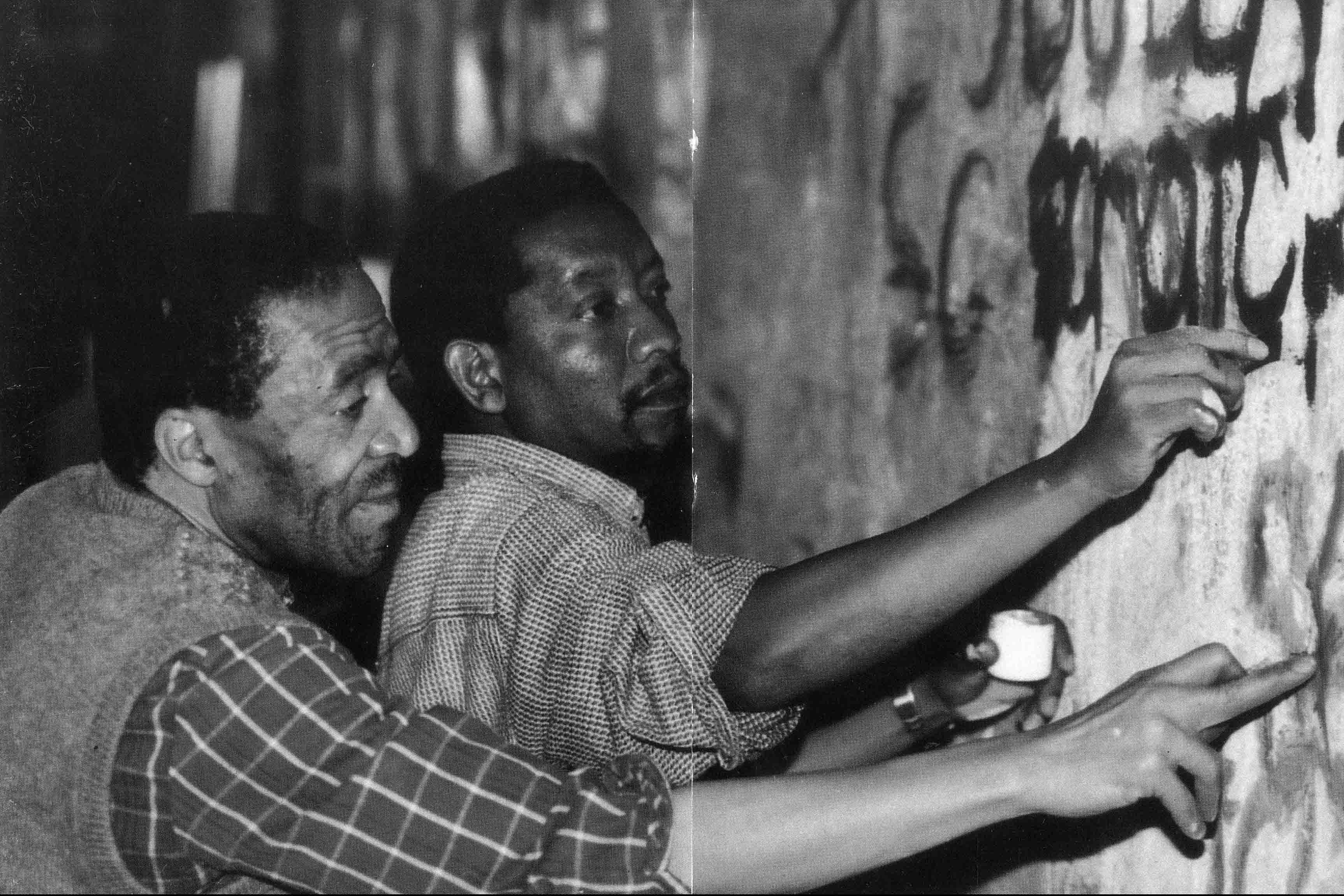 1997: Koloane with friend and fellow artist Pat Mautloa at the National Festival of the Arts, working on the mural If You Scratch at the Monument Theatre. (Photograph: Supplied)