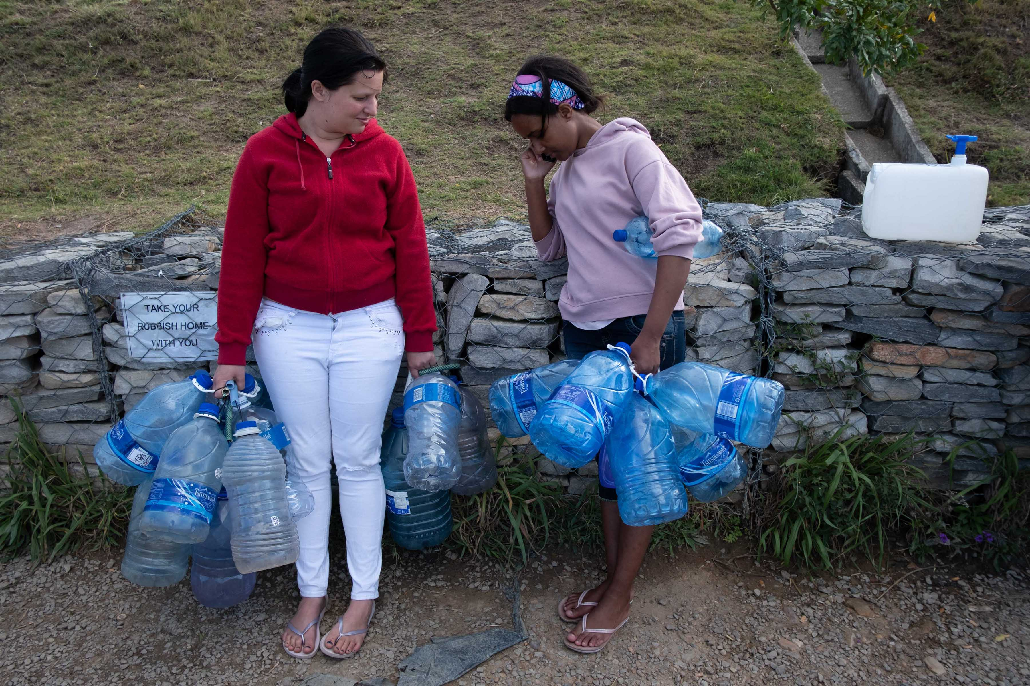 12 November 2019. Neighbours Maryanne Quinton and Cuma Boltina queuing at the freshwater spring on the outskirts of Makhanda. A lack of service delivery and foresight from the government is said to be exacerbating the effects of the drought.