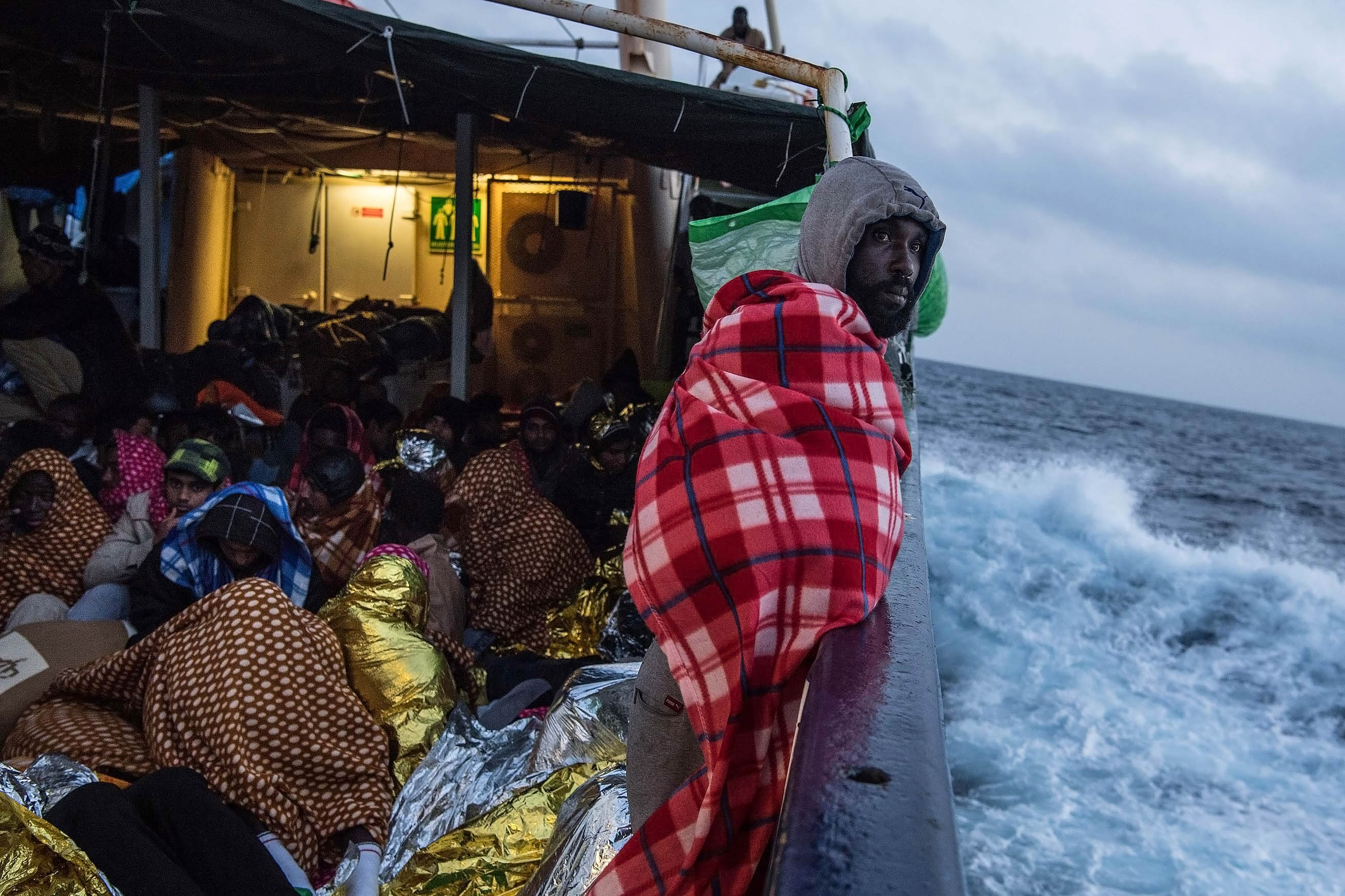 19 February 2017: Refugees and migrants on the deck of a Spanish rescue vessel, sailing towards the Italian port of Pozzallo after being rescued off the coast north of Sabratha, Libya. (Photograph by David Ramos/Getty Images)