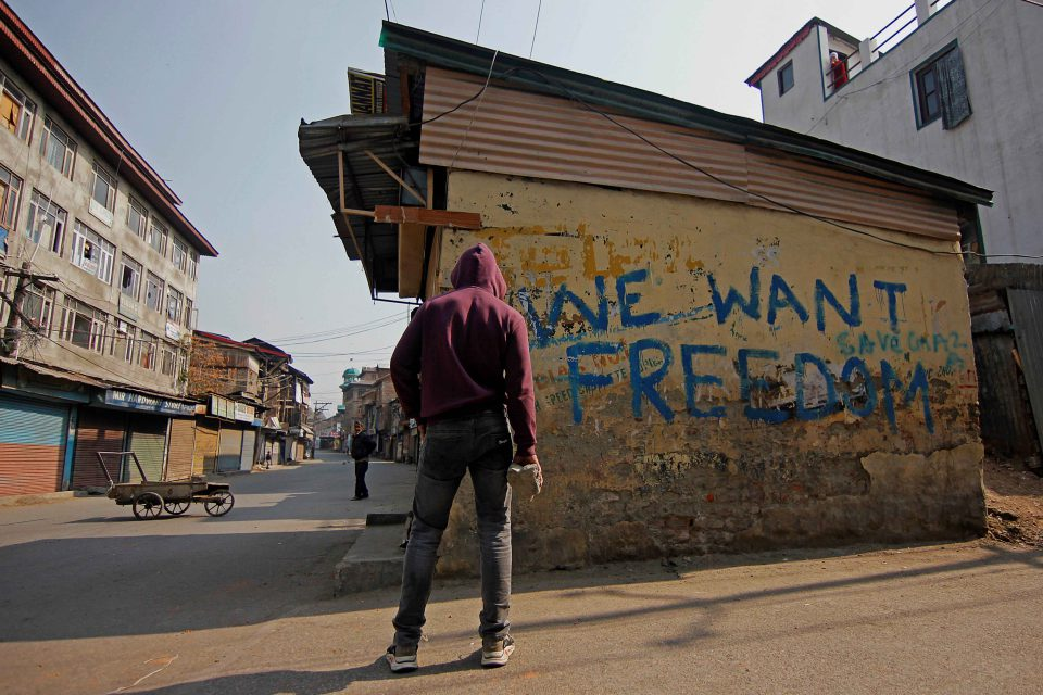 29 October 2019: A protester in Srinagar. Protests and clashes were reported in many areas of Kashmir following a visit by European lawmakers after the Indian government revoked Kashmir's autonomy. (Photograph by Faisal Khan/Anadolu Agency via Getty Images)