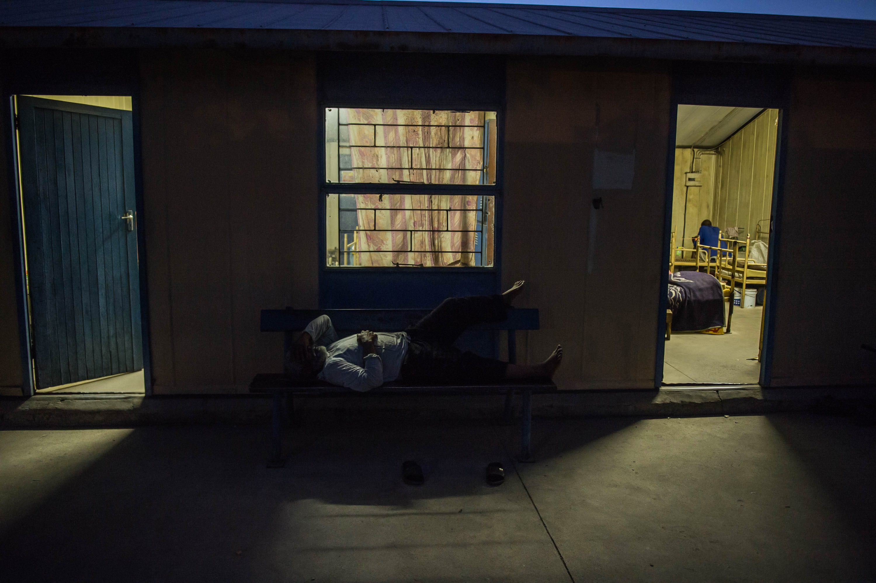 29 October 2019: A miner resting outside the Kroondal Hostel. Workers have been waiting for pension payouts for more than 10 years at a platinum mine in the North West.