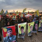 8 November 2015: A funeral procession for eight members of the Kurdish People's Protection Units, seven of whom were killed by an Isis car bomb, in Derek, Rojava, Syria. (Photograph by John Moore/Getty Images)