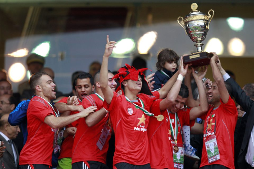 1 May 2013: USM Alger's players celebrate with the trophy after winning their Algeria Cup final soccer match against MC Alger in Algiers. (Photograph by Reuters/ Louafi Larbi)