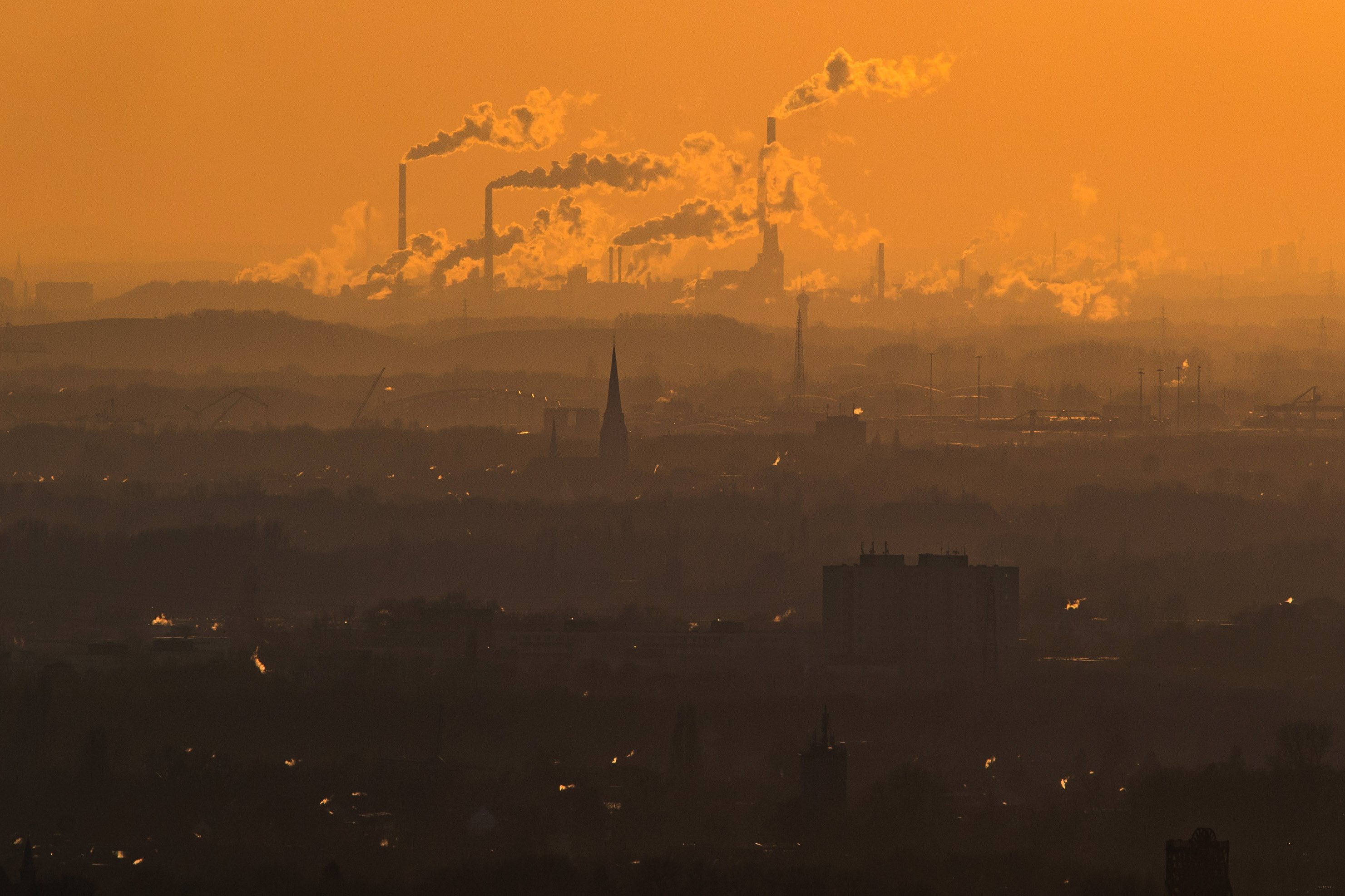 6 January 2019: Steam and exhaust fumes rise from different polluters on a cold winter day in Oberhausen, Germany. Greenhouse gases are among the chief causes of global warming and climate change. (Photograph by Lukas Schulze/Getty Images)