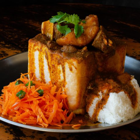 Undated: A quarter mutton bunny chow with sambals, iconic Durban street food that is made by hollowing out white bread and filling it with curry. (Photograph by Jonathan Oberholster/Alamy Stock Photo)