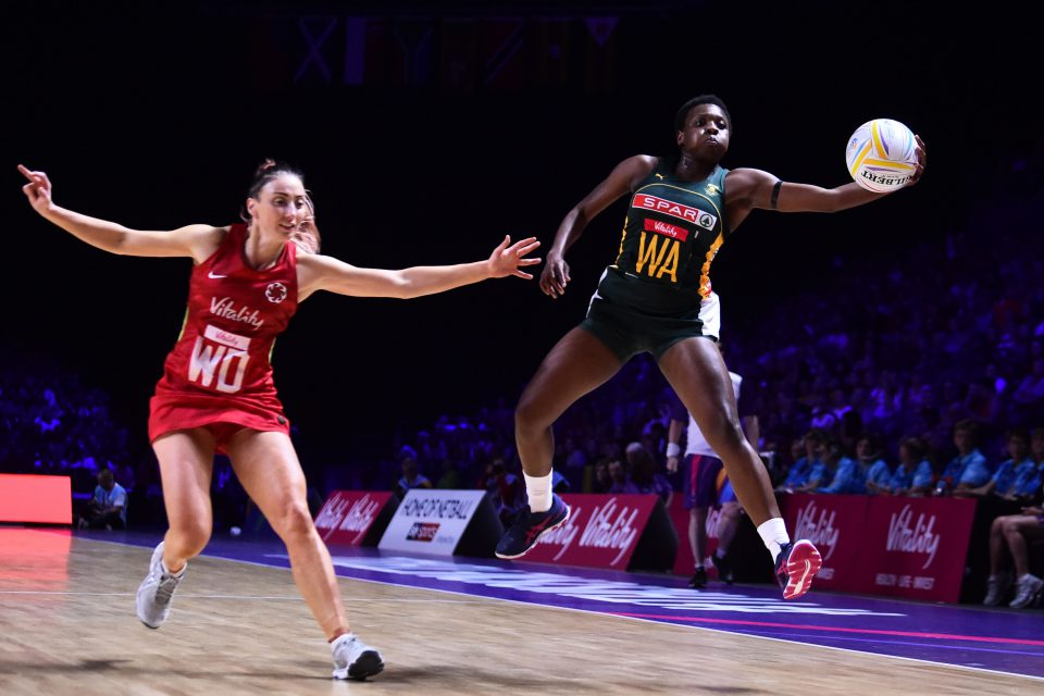18 July 2019: From left, Jade Clarke of England and Khanyisa Chawane of South Africa playing during stage two of the preliminaries of the Netball World Cup in Liverpool, England. (Photograph by Nathan Stirk/Getty Images)