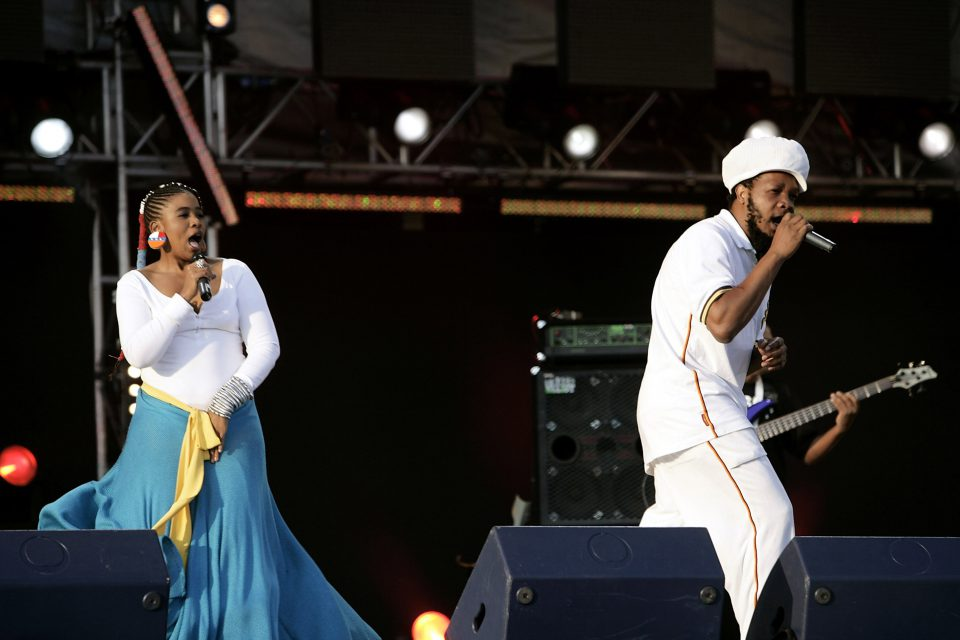 11 June 2005: From left, Bongo Maffin members Thandiswa Mazwai and Adrian Mupemhi performing at the 46664 Arctic concert at Fyllingen in Tromso, Norway. (Photograph by Dave Hogan/Getty Images)