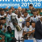 14 December 2019: Centre, Captain Hlompho Kekana celebrates with Mamelodi Sundowns after winning the Telkom Knockout final against Maritzburg United at Moses Mabhida Stadium in Durban, South Africa. (Photograph by Anesh Debiky/Gallo Images)