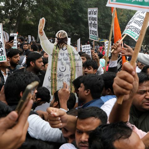 11 December 2019: Opposition supporters with a cardboard cutout of Minister of Home Affairs Amit Shah at a protest in New Delhi against a bill granting citizenship to persecuted religious minorities in neighbouring Muslim countries. (Photograph by Reuters/Anushree Fadnavis)