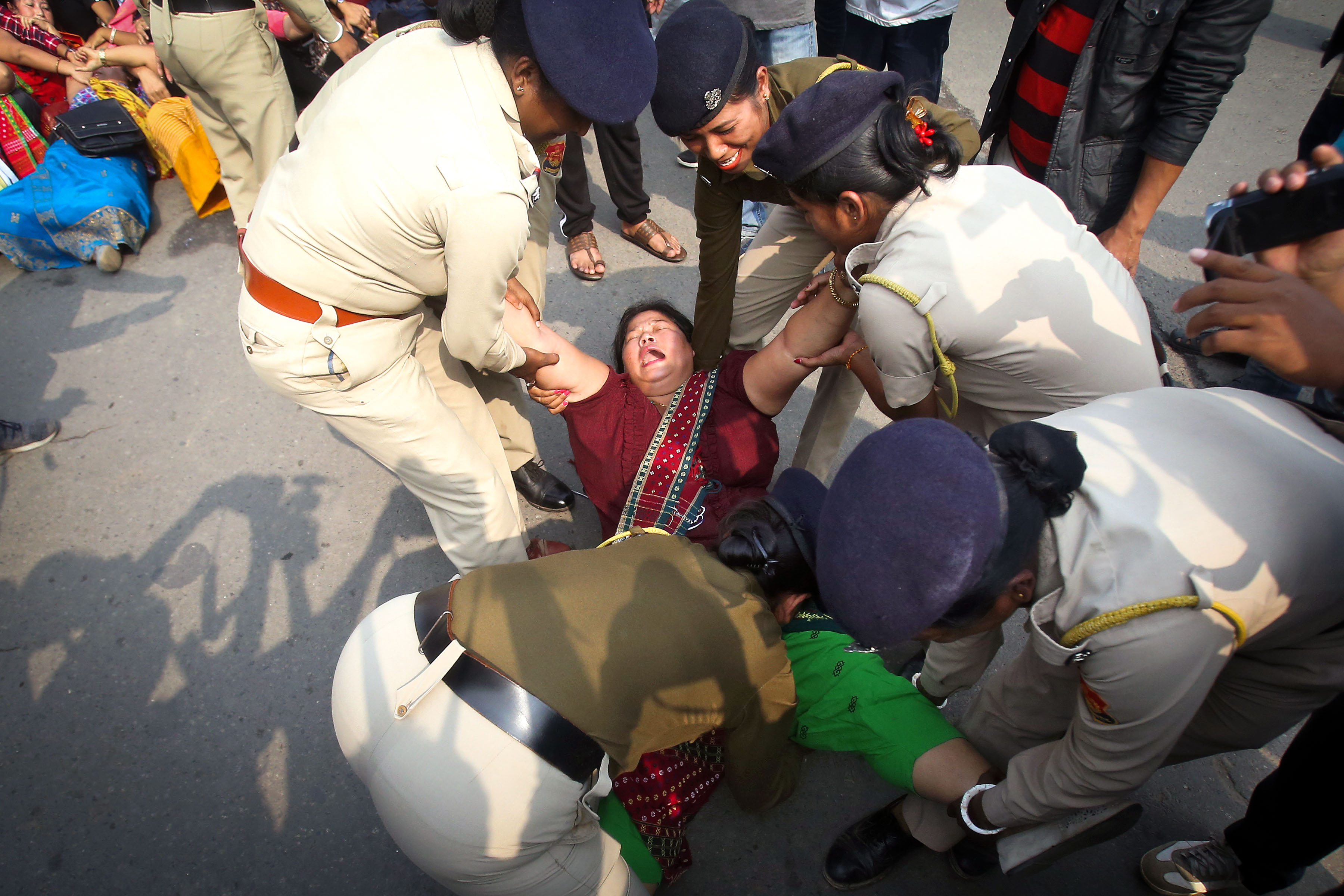 10 December 2019: A demonstrator in Agartala, India, being detained by the police during a protest against the Citizenship Amendment Bill. (Photograph by Reuters/Jayanta Dey)