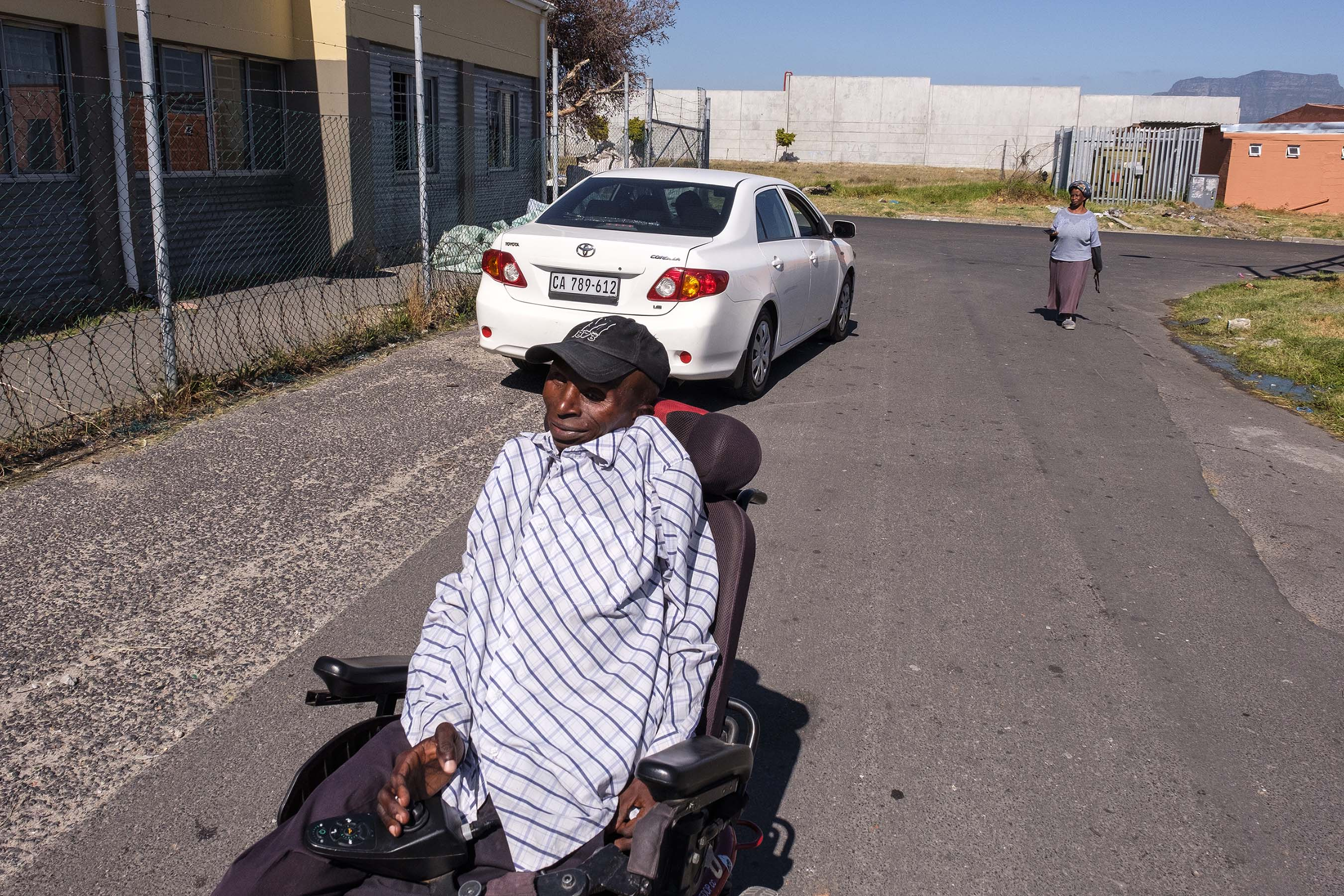 22 November 2019: Thozi Mciki is able to walk, but slowly because of his limited mobility. Before getting his specialised wheelchair in 2017, his sister Noam-India Mciki (right) would make the slow commute on foot with him.