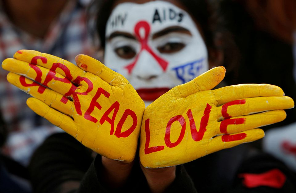 30 November 2018: A student with her face and hands painted during an HIV and Aids awareness campaign on the eve of World Aids Day in Chandigarh, India. (Photograph by Ajay Verma/Reuters)