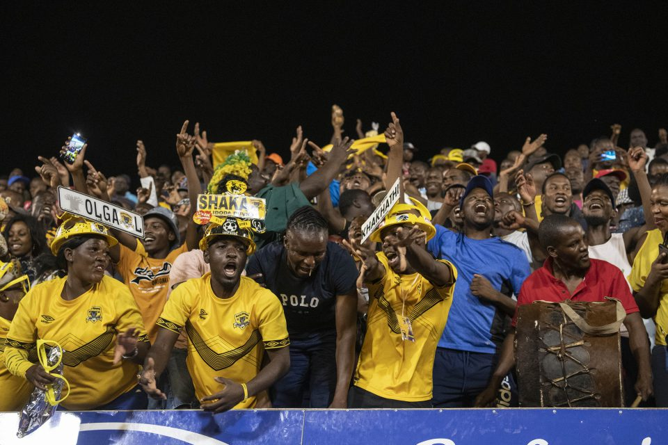 30 November 2019: Black Leopards fans on the Zamalek stand celebrate as their team scores a goal.