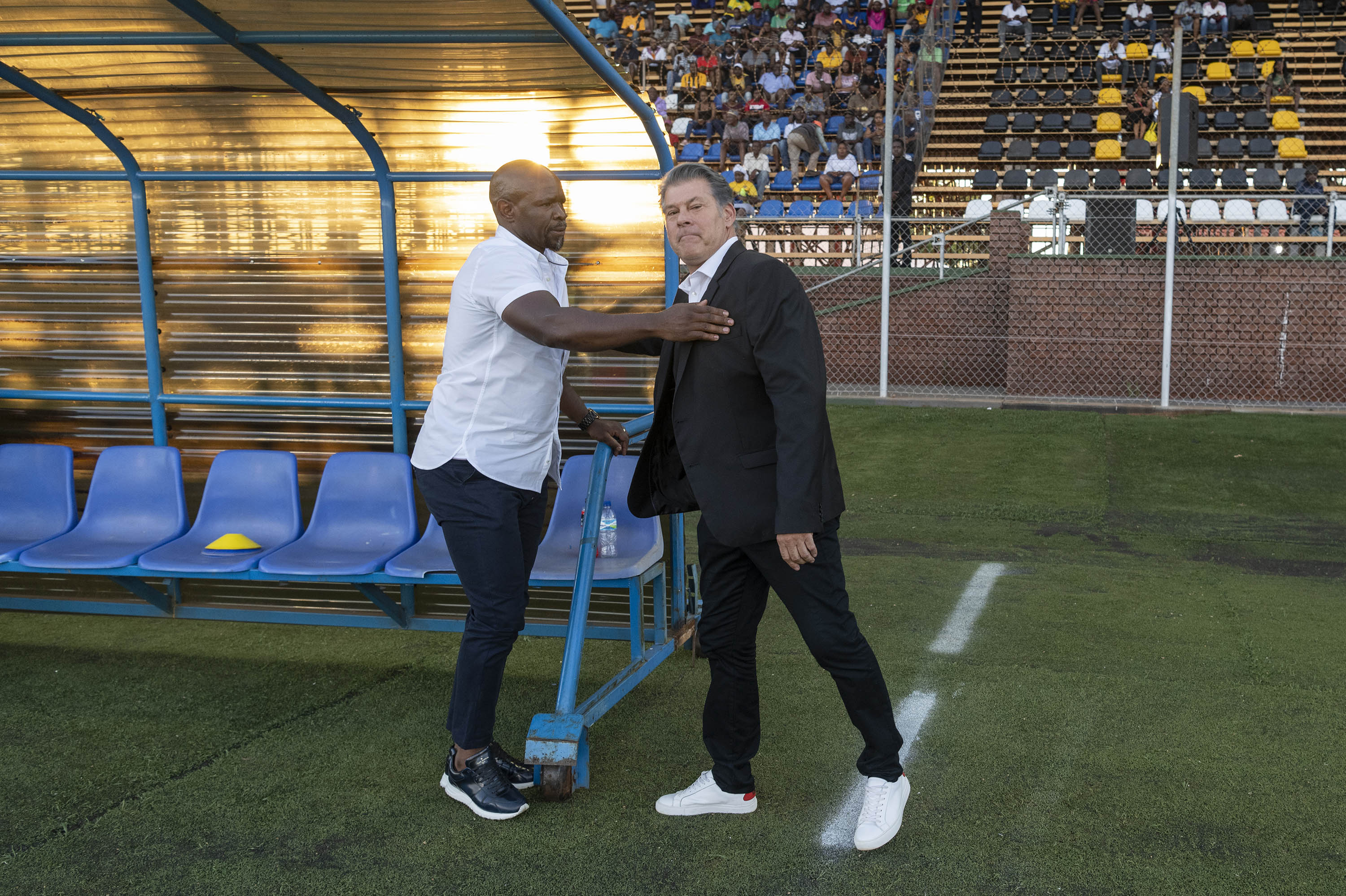 30 November 2019: From left, a frosty handshake between Arrows' Steve Komphela and Leopards' Luc Eymael, who have waged a war of words since Eymael stopped just short of saying he would love to join Kaizer Chiefs during Komphela's troubled stint.