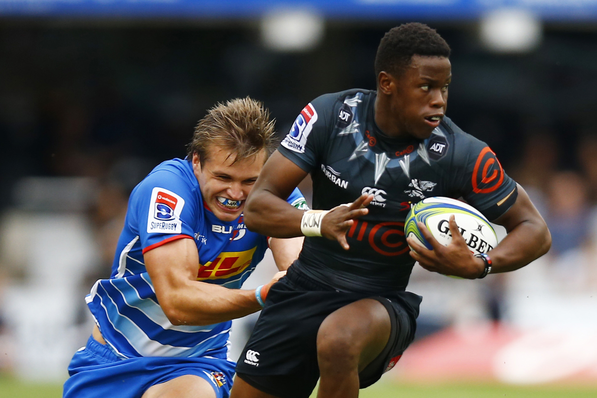 2 March 2019: (From left) Jean-Luc du Plessis of the Stormers coming in for the tackle on Aphelele Fassi of the Sharks during a Super Rugby match at Jonsson Kings Park in Durban. (Photograph by Steve Haag/Gallo Images)