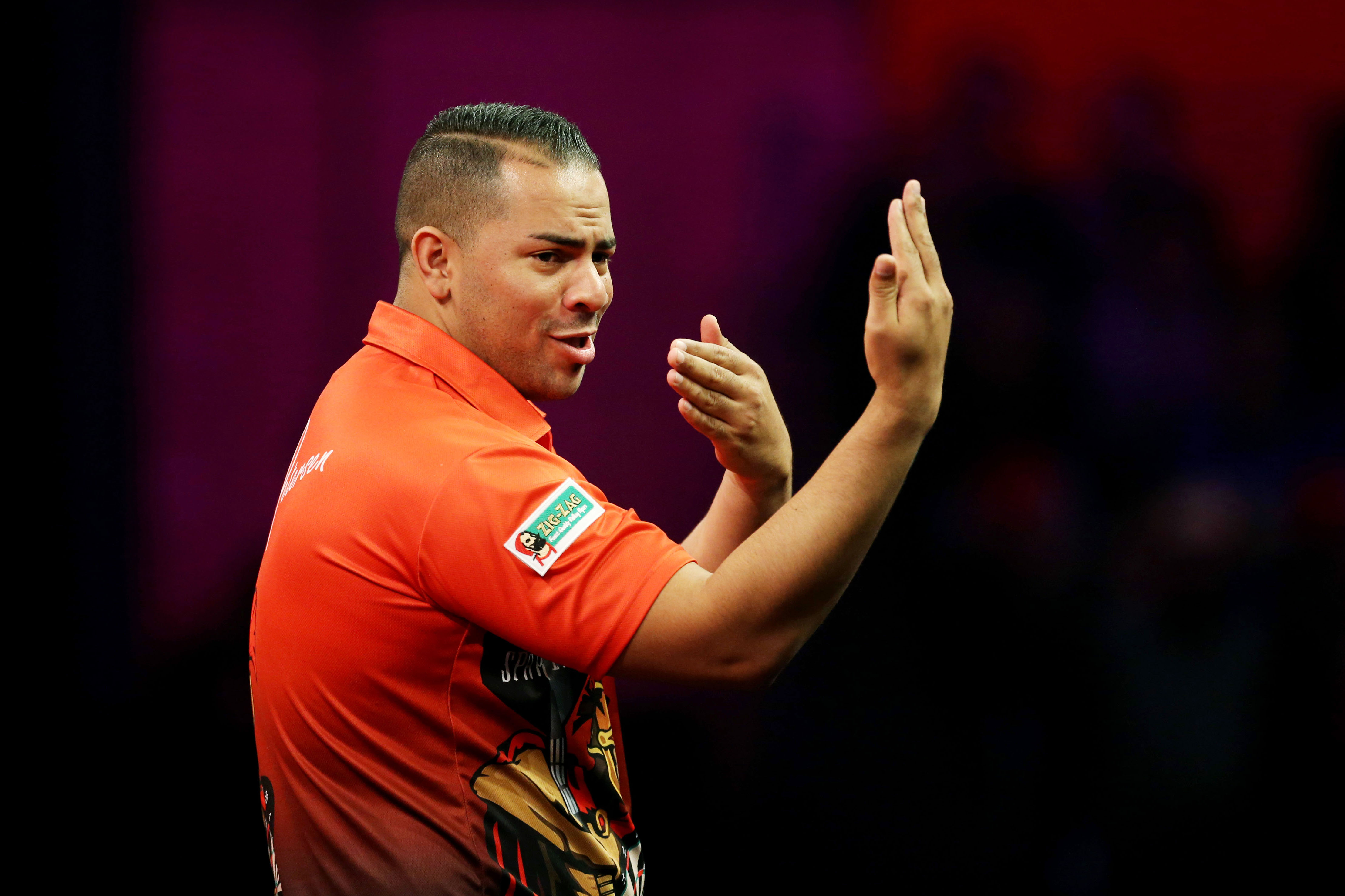 27 December 2013: Devon Petersen during his walk-on for the second round of the 2014 Ladbrokes World Darts Championship at Alexandra Palace in London, England. (Photograph by Action Images/Steven Paston)