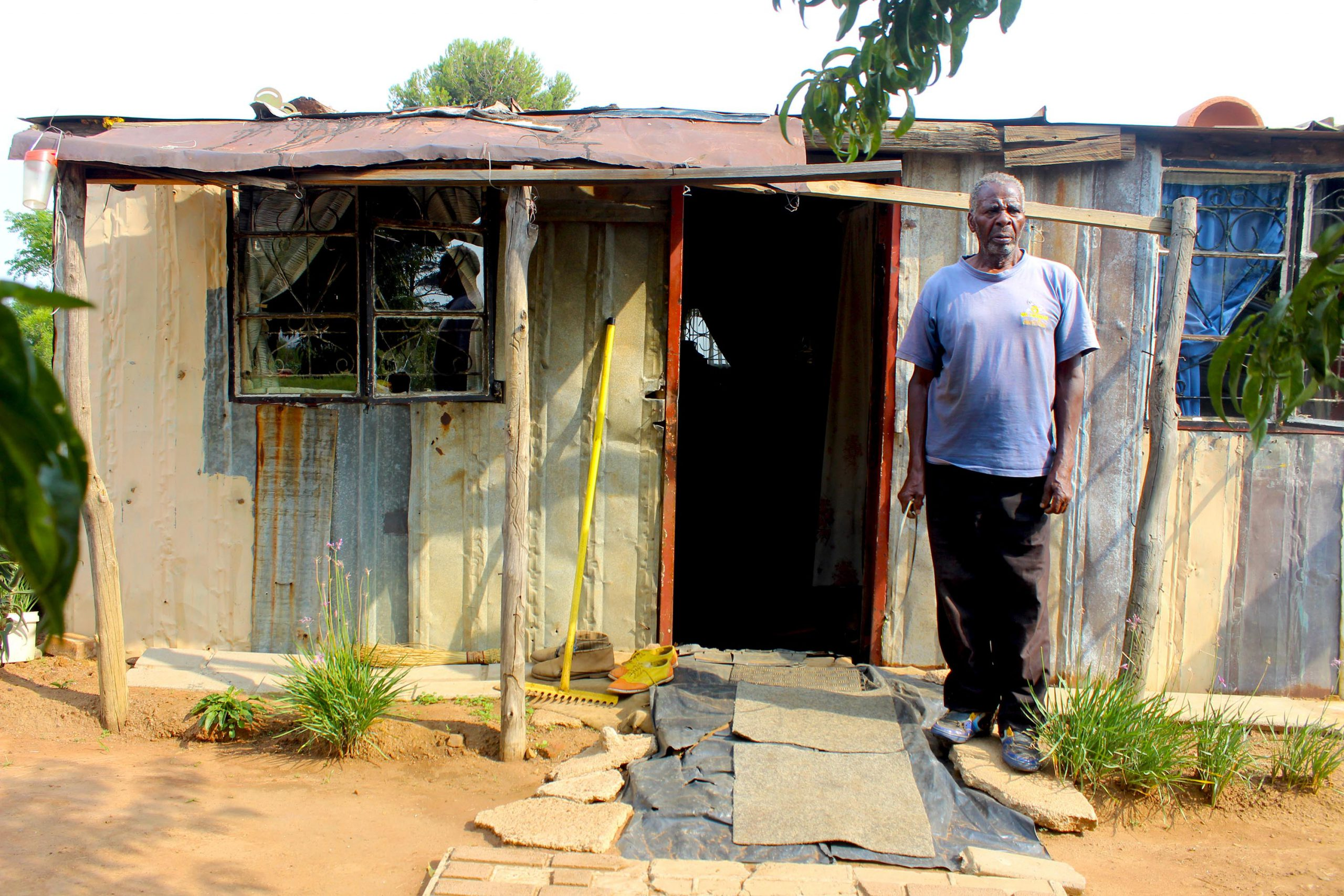 18 March 2019: Mahlomelane Johannes Mthembu outside the shack he has built using his pension money while waiting for the government to build him a house. (Photograph by Funiwe Ngwenya)