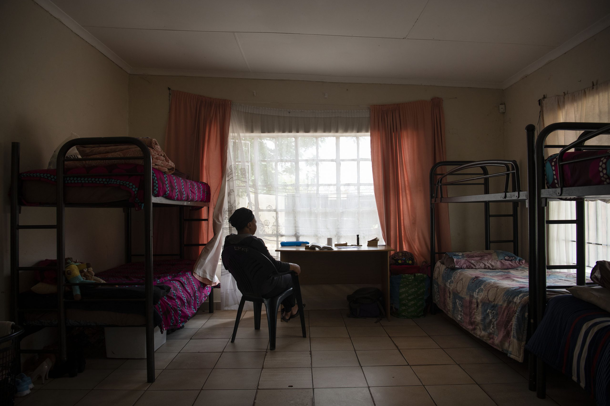13 December 2019: A resident in her room at the women's shelter.