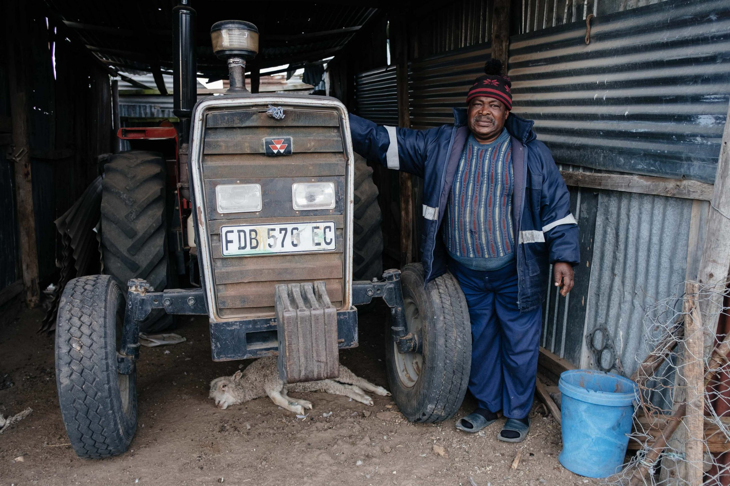 10 November 2019: Farmer Samuel Mthobeli Mwahla, 67, at his tractor shed in Nqgwele Village near King William's Town in the Eastern Cape. Unpredictable rainfall has meant that many locals have held off on planting crops in newly ploughed land.