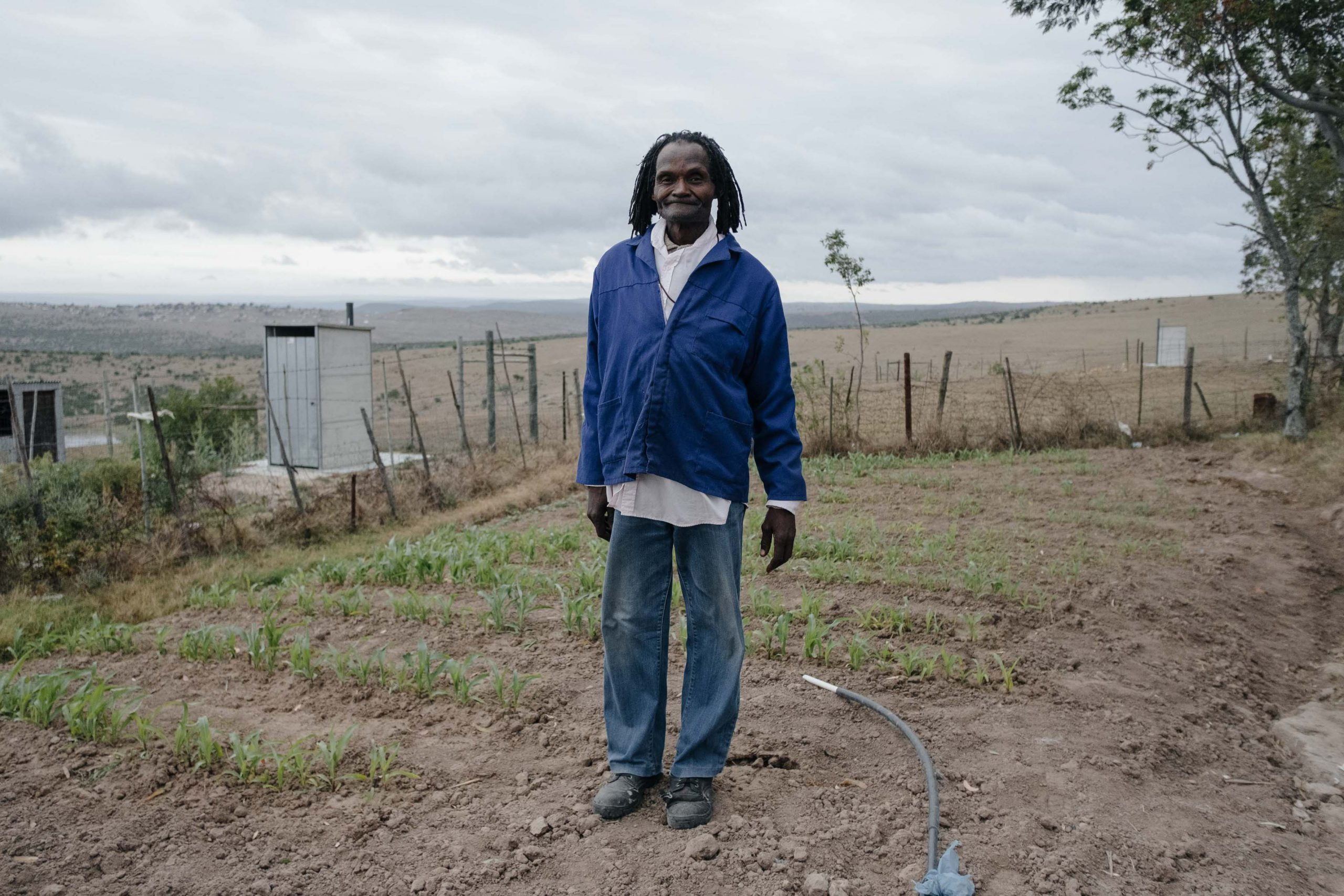 10 November 2019: Subsistence farmer and traditional healer Goodman Bhacela, 70, at his homestead in Ngqwele Village in the Eastern Cape. Unpredictable and insufficient rainfall has forced him to rely on municipal tap water to save his crop.