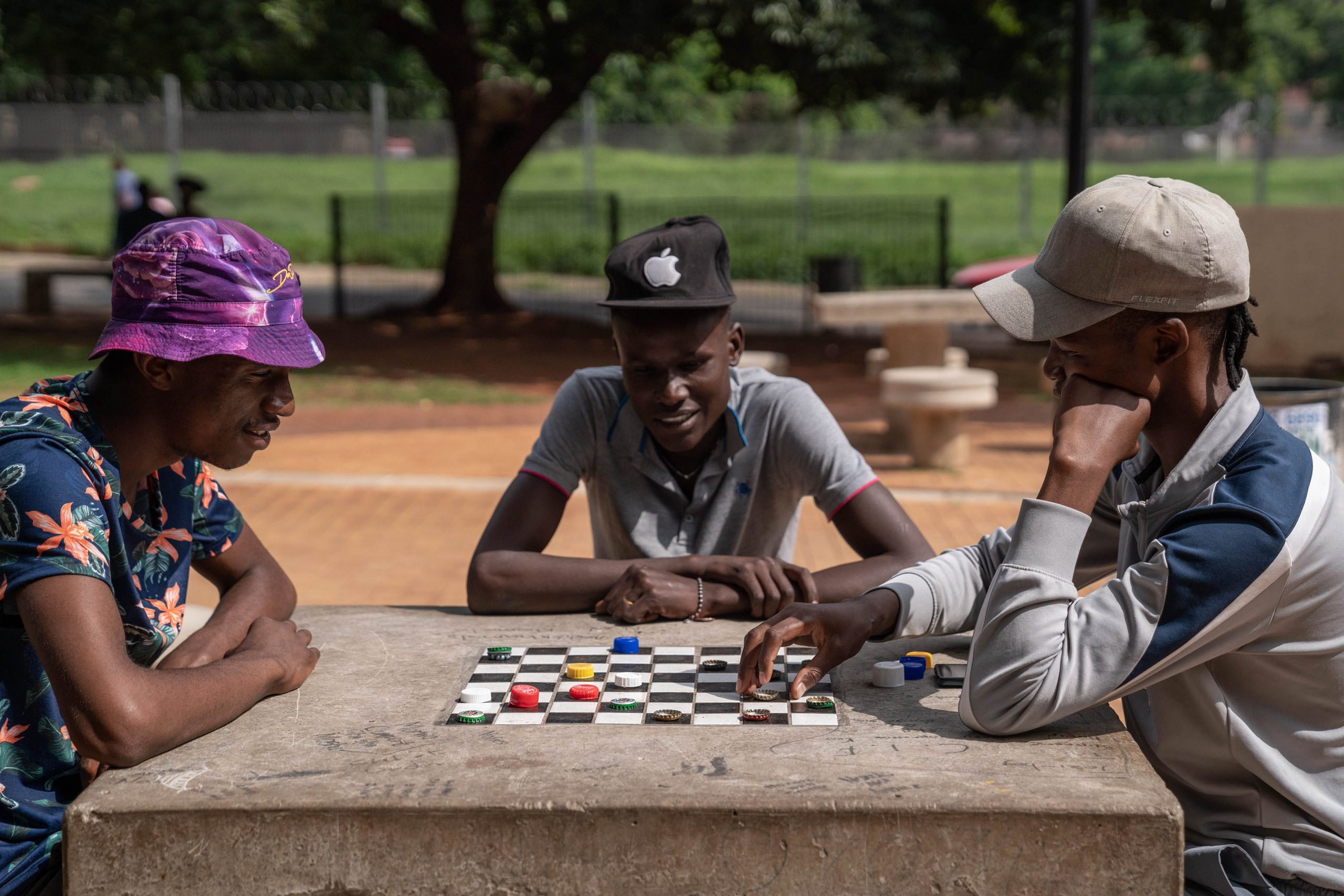 15 January 2020: Three of the park's draught-playing regulars enjoying a game.