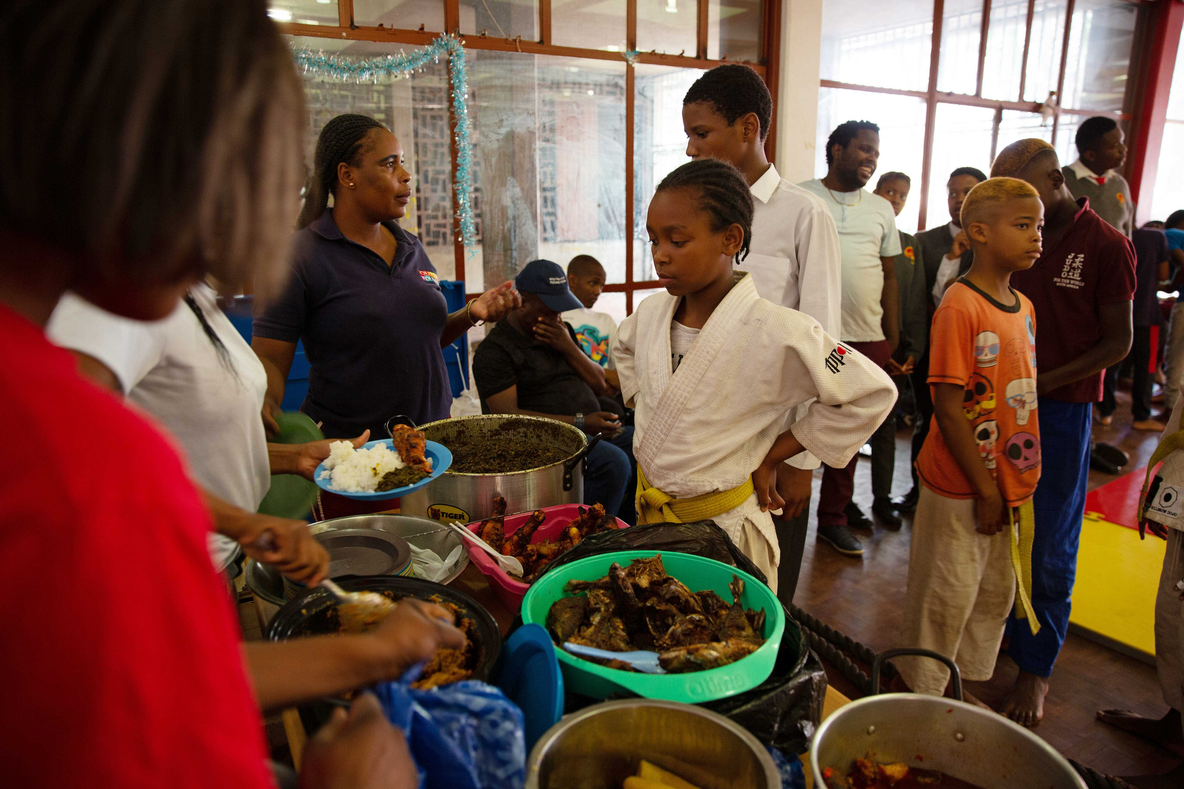 14 November 2019: Stacey Dube, 12, queues for her plate of Congolese food.