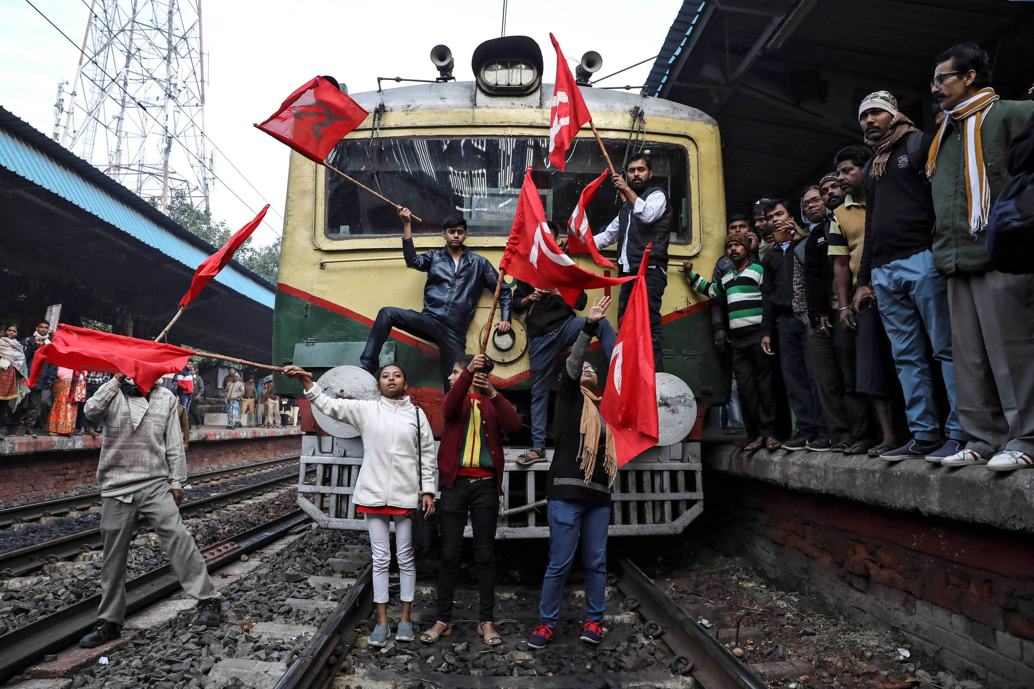 8 January 2020: Communist Party of India (Marxist) supporters blocking a passenger train during an anti-government protest rally organised as part of a nationwide strike by various trade unions in Kolkata, India. (Photograph by Reuters/Rupak De Chowdhuri)