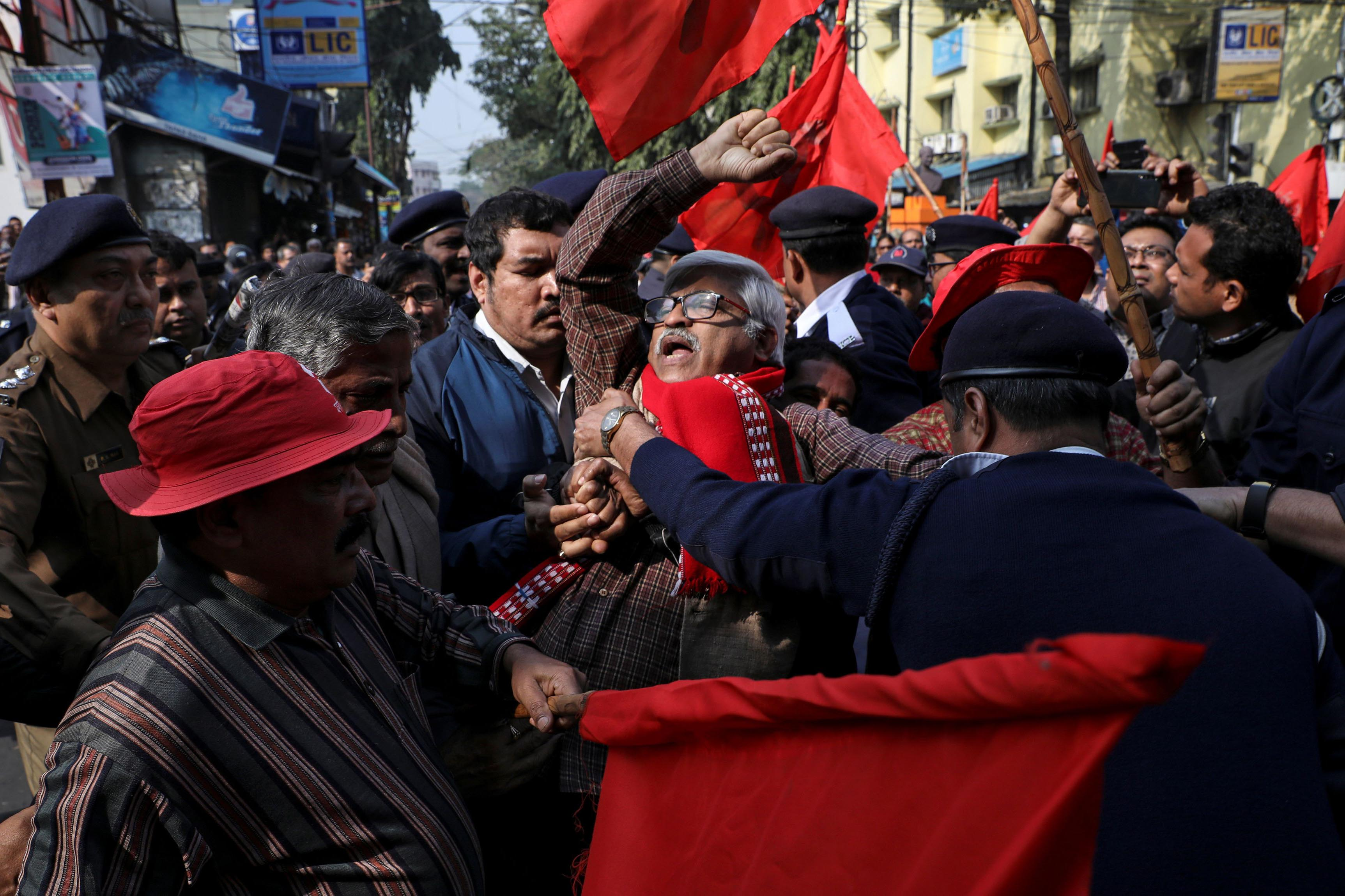 8 January 2020: A supporter of the Communist Party of India (Marxist) being detained during a protest against the government in Kolkata, India. (Photograph by Reuters/Rupak De Chowdhuri)