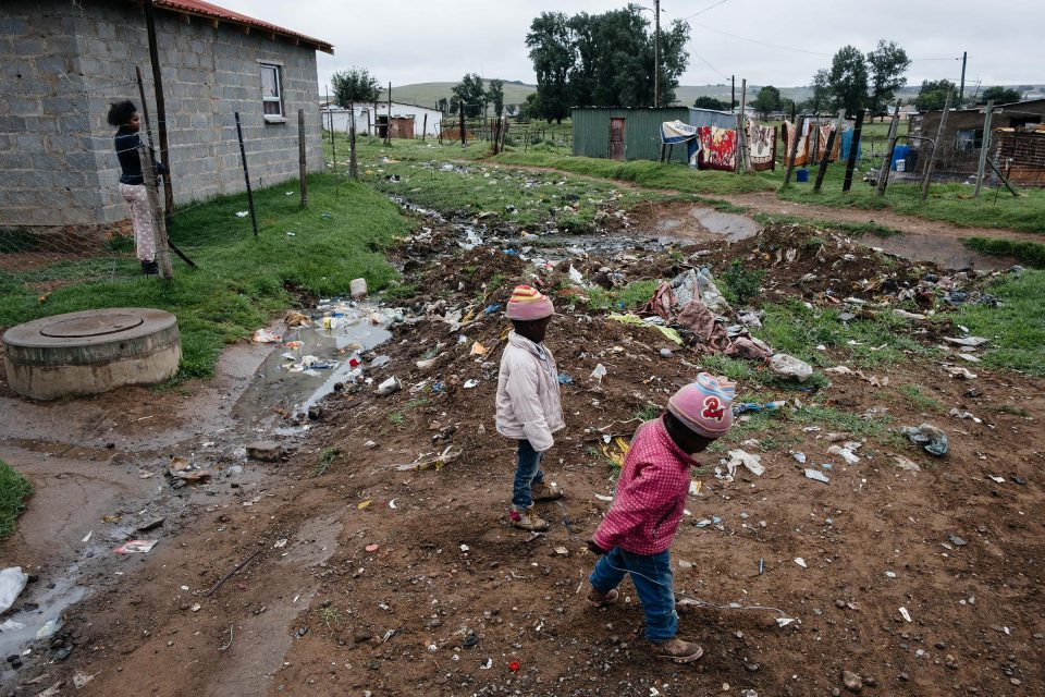 10 December 2019: Children play in rubbish and raw sewage on a street in Old Location, Kowa, in the Eastern Cape.