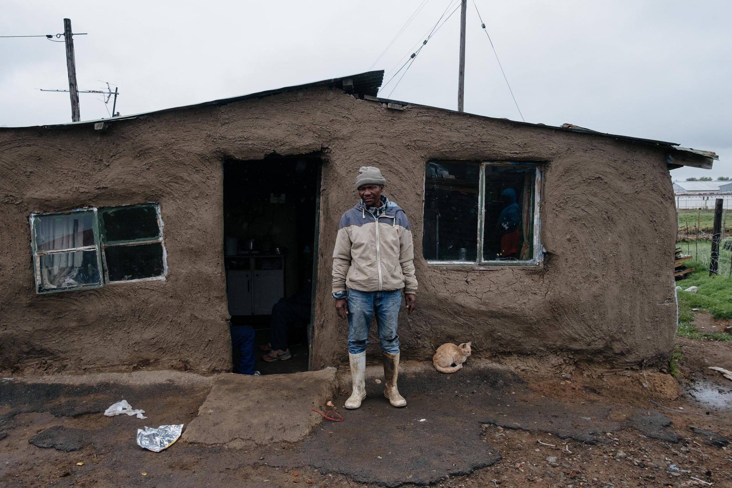 10 December 2019: Mnikelo Tywhili, 46, outside his house in Old Location, Kowa. He has built his house using the traditional method of mud over a timber frame.
