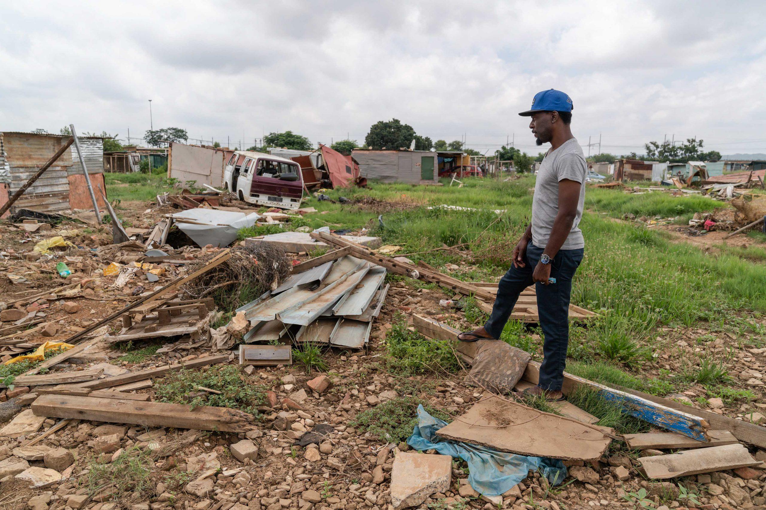 "21 January 2020: Hakeem ""OJ"" Matibela, a Seven Seven founding resident and settlement leader, surveys a flood-damaged area."