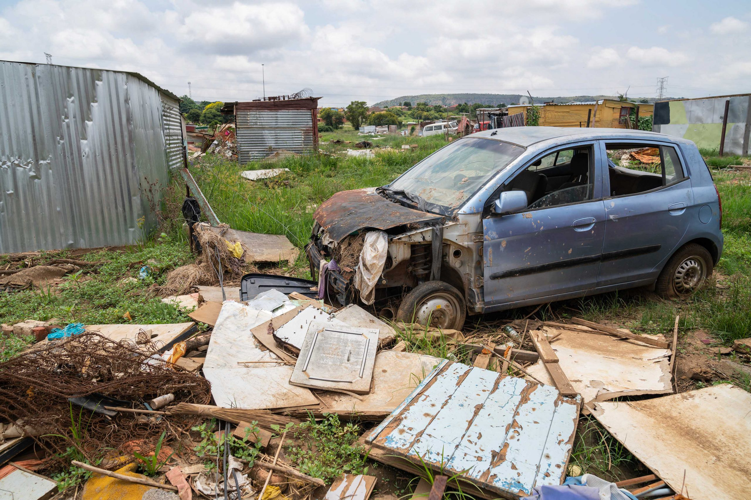21 January 2020: A car that was swept away and damaged by flood waters from the nearby Moretele river that surged through the Seven Seven shack settlement in December last year.