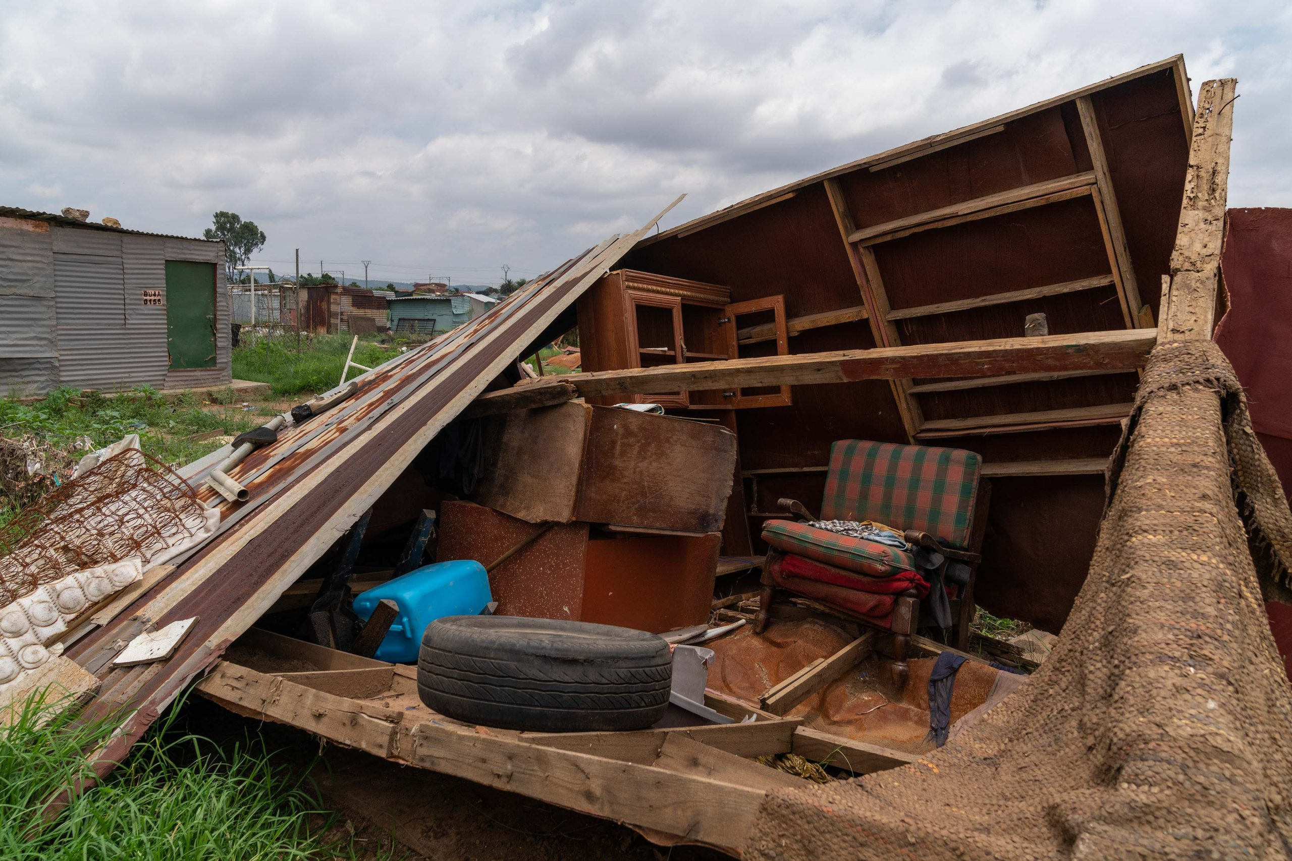 21 January 2020: Inside a gutted shack home at Seven Seven, a resident has salvaged some furniture from the floods.