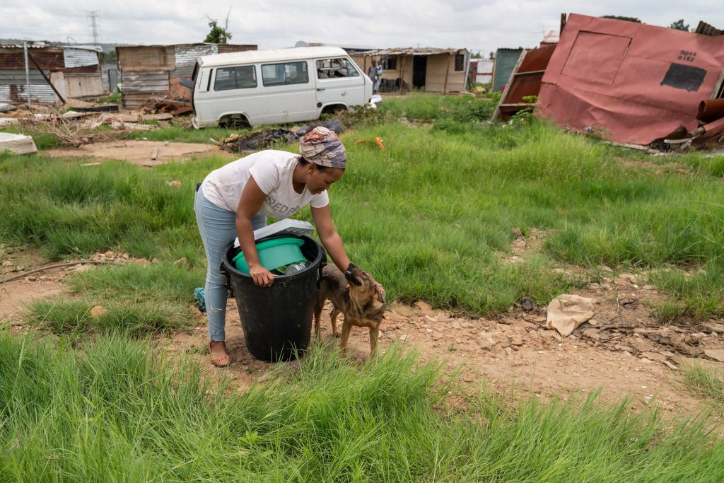 21 January 2020: Glenda Mashoeshoe with her beloved dog Danger that she feared had drowned in the flood. Mashoeshoe was trapped inside her home with her young daughter but managed to survive. Danger returned when the floodwaters subsided.
