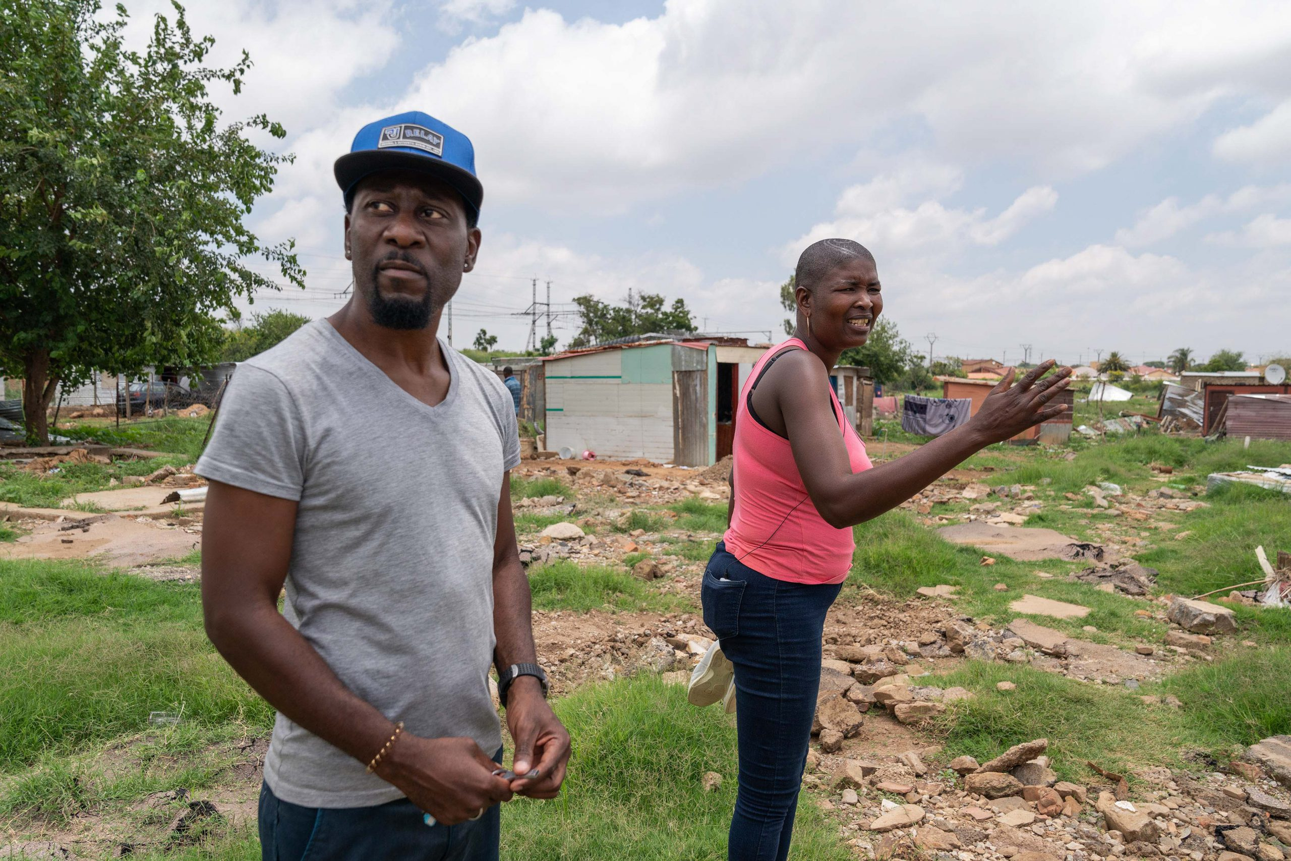 "21 January 2020: From left, Hakeem ""OJ"" Matibela and Veronica Marota. Marota was trapped under a car during the floods but was rescued by Matibela and others."