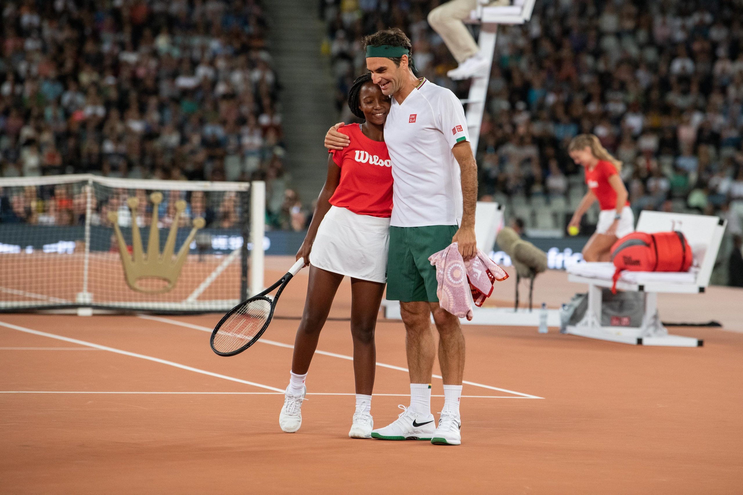7 February 2020: Roger Federer hugs a ball girl who played a point on his behalf during the Match in Africa.