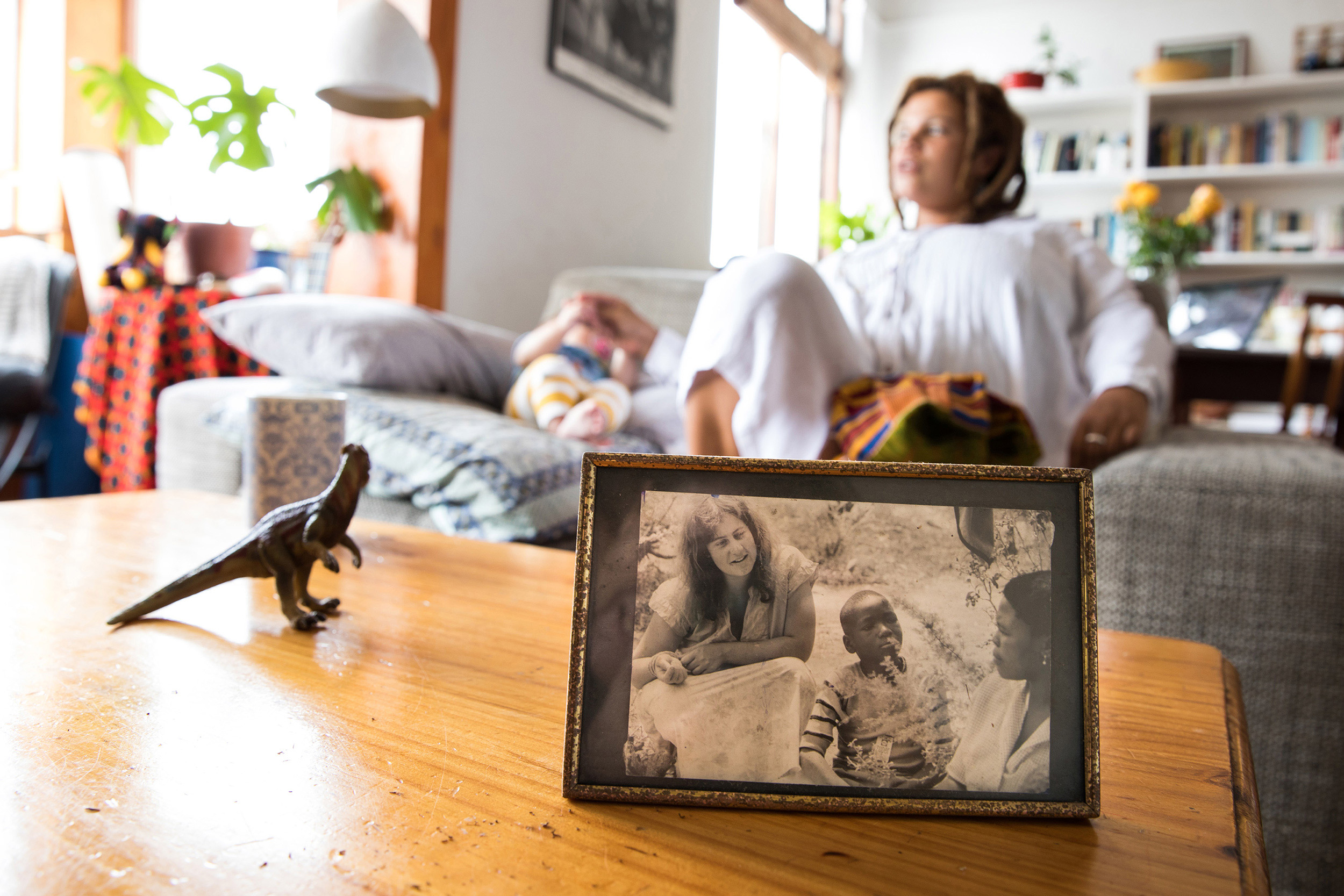 25 November 2018: Clare Stewart's daughter, Puleng, at home in Cape Town with a picture of her mother on the coffee table.