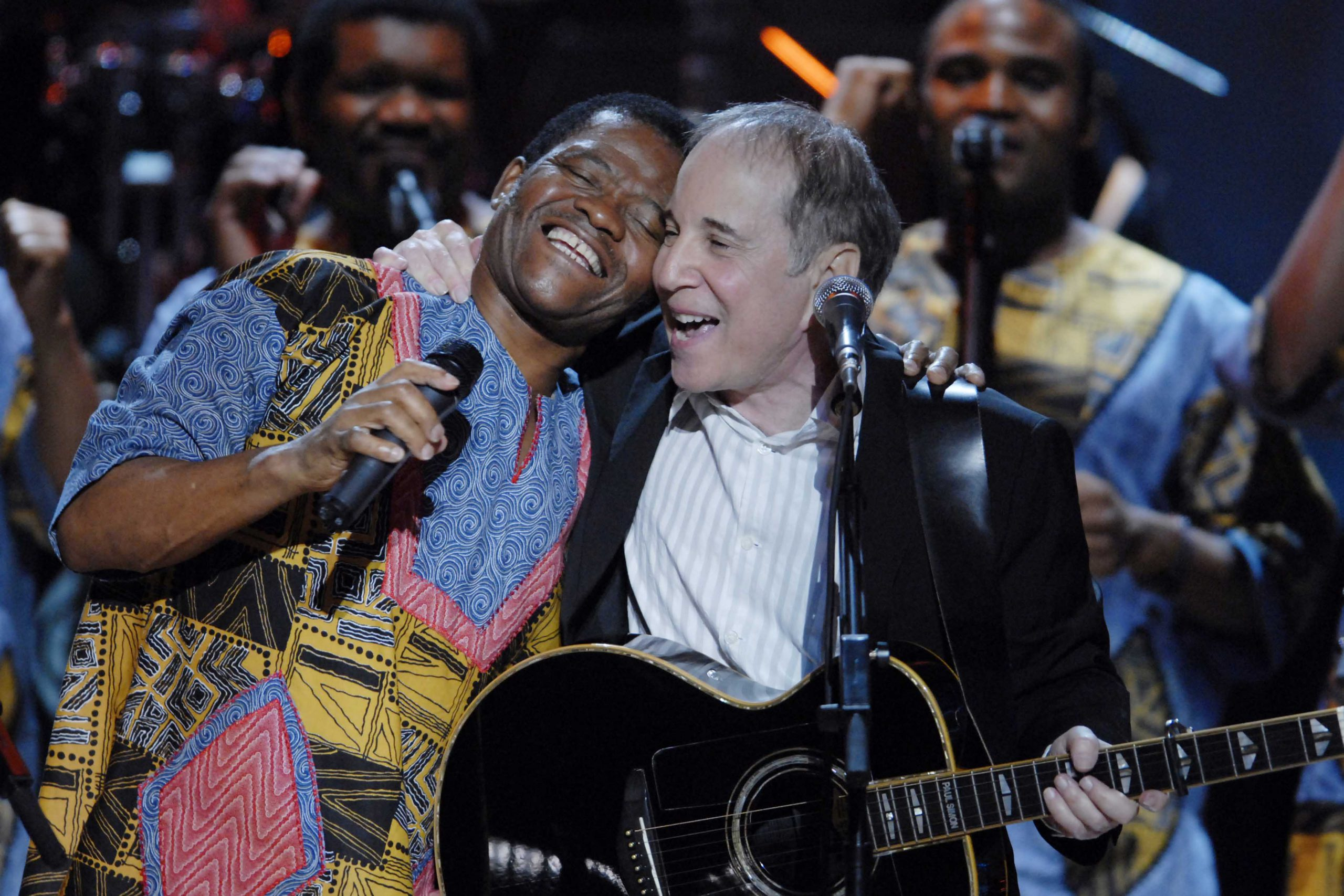 23 May 2007: Paul Simon with Ladysmith Black Mambazo at the Warner Theatre in Washington, DC. They worked with him on his 1986 album Graceland, co-writing Homeless, which has a melody based on a Zulu wedding song. (Photograph by Scott Suchman/WireImage)