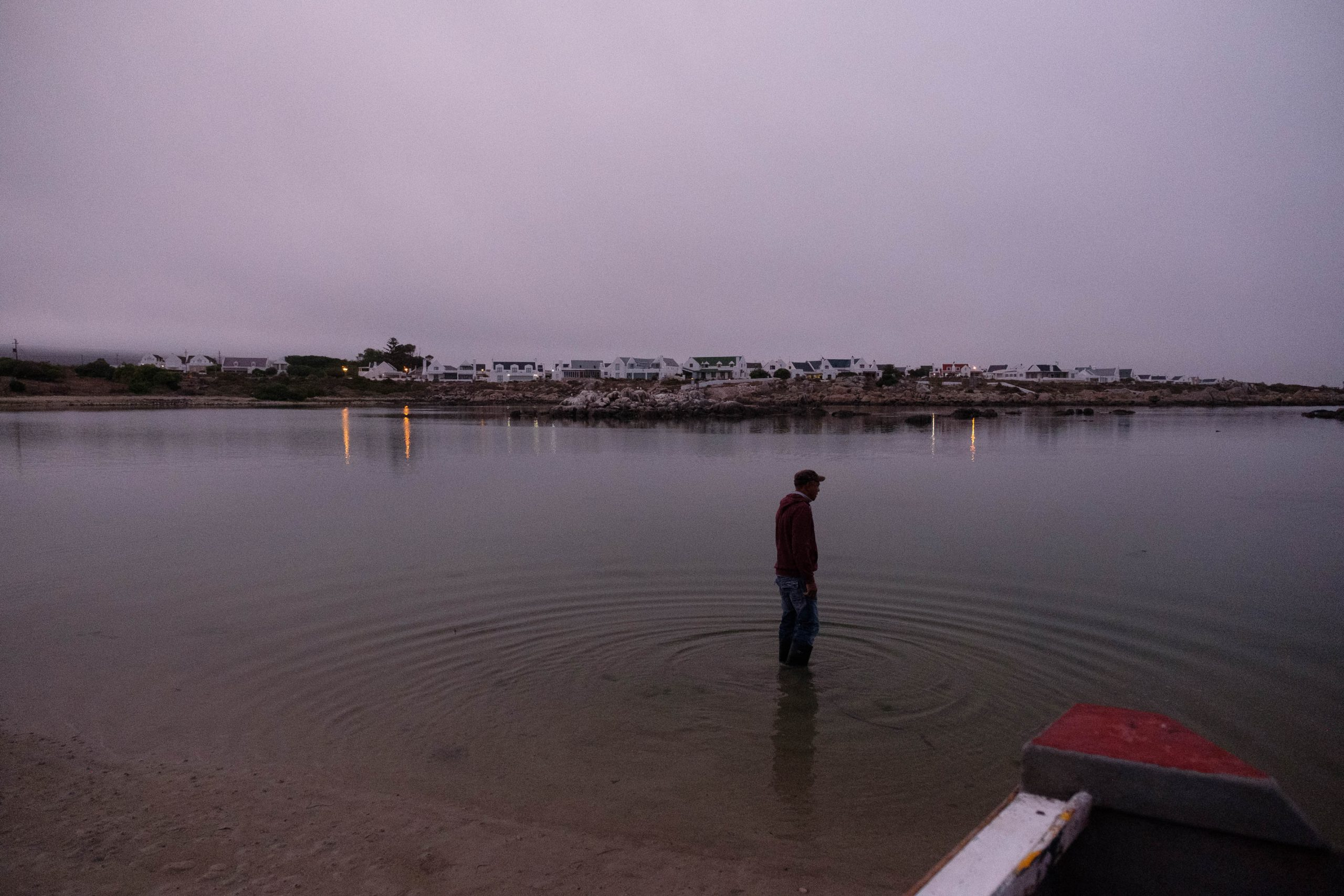 06 December 2019: Christian Adams in the water at Jacobsbaai looking for the ideal launch point for his boat.