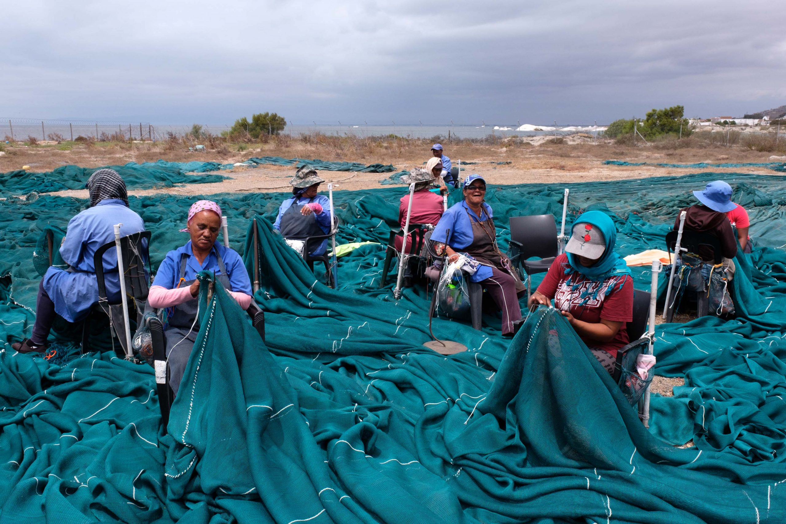 22 January 2020: Women repair the surfaces of the fishing nets while the heavier work of fixing the seams is left to men.