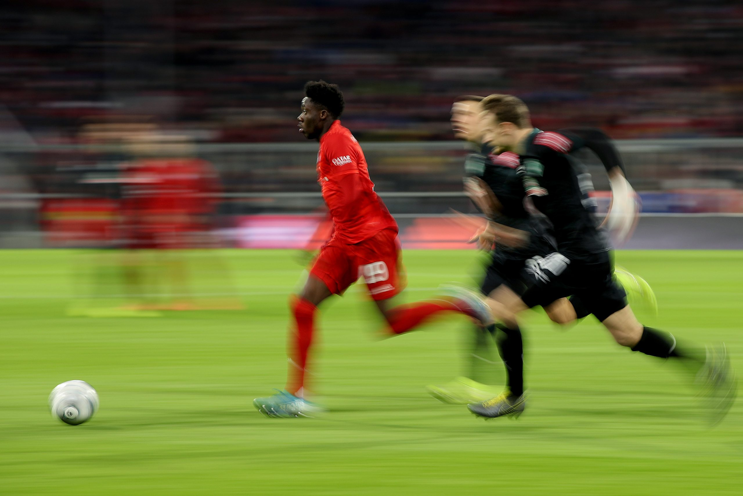 14 December 2019: Bayern Munich's Alphonso Davies battles for the ball during a Bundesliga match against Werder Bremen in Munich, Germany. (Photograph by Alexander Hassenstein/ Bongarts/ Getty Images)