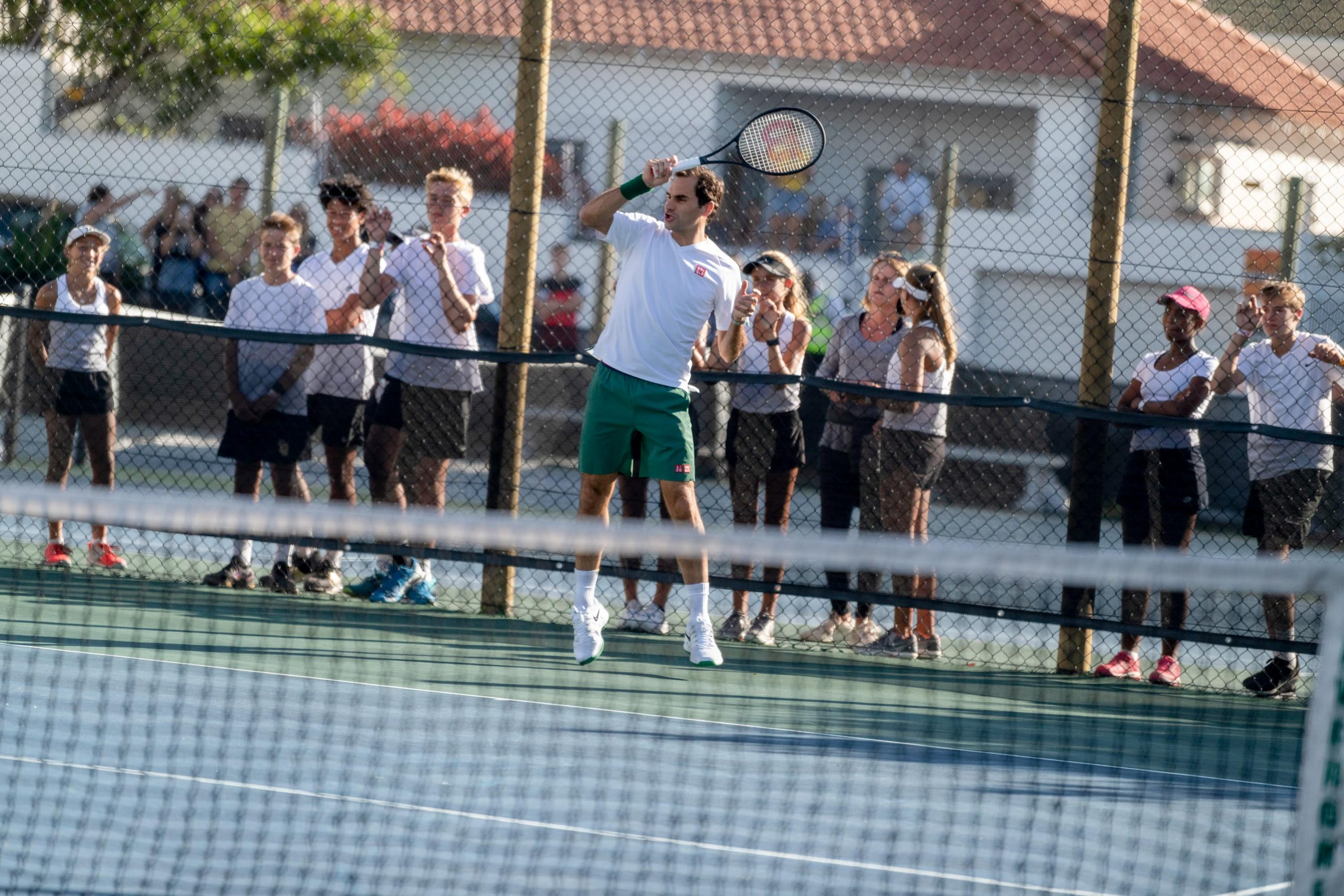 6 February 2020: Young players watch as Roger Federer plays a shot during an event at the Anthony Harris Tennis Academy ahead of Match in Africa 6. (Photograph by Ihsaan Haffejee)