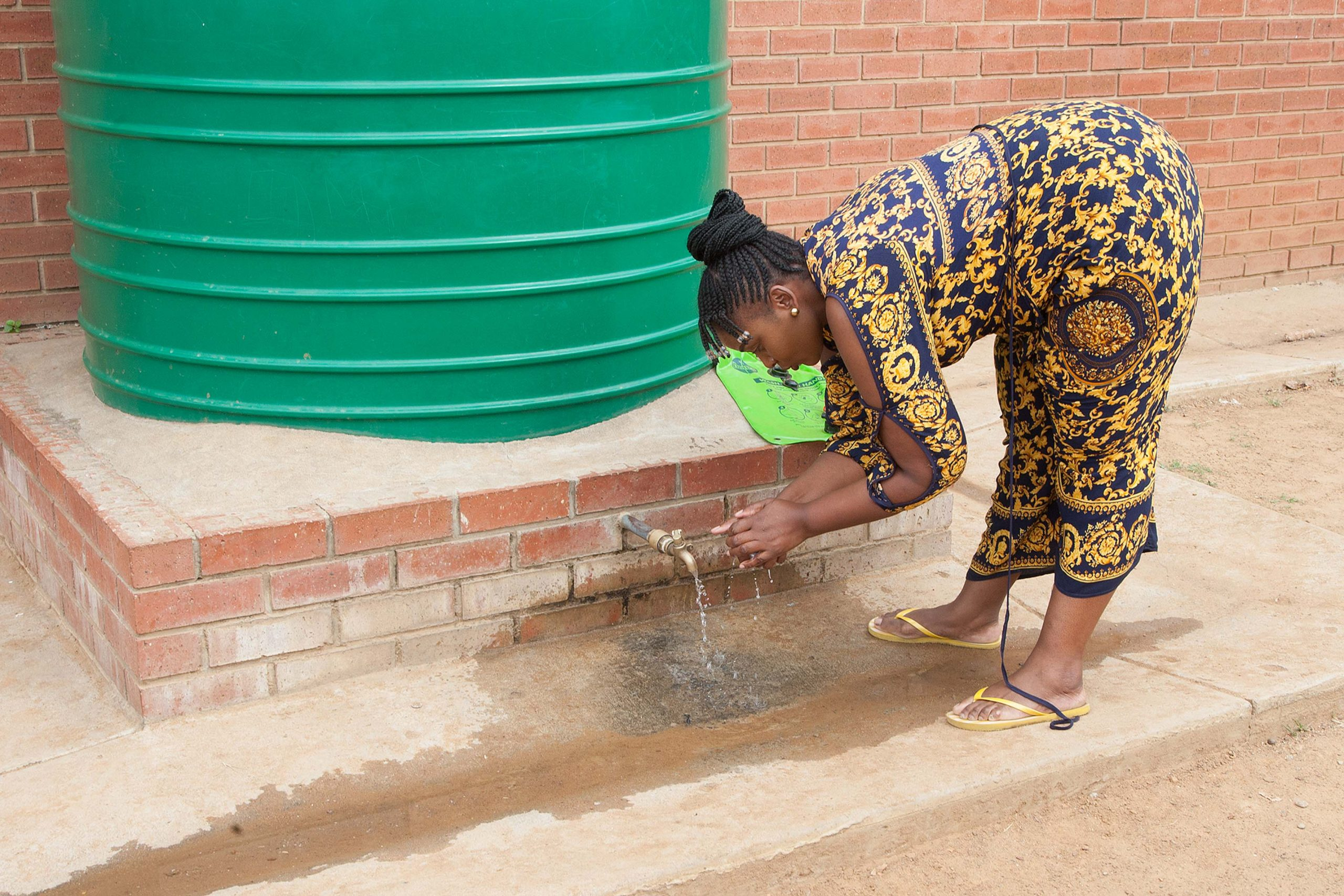 13 March 2020: Teacher Bongumusa Mdluli washes her hands at Khethelihle Primary School.