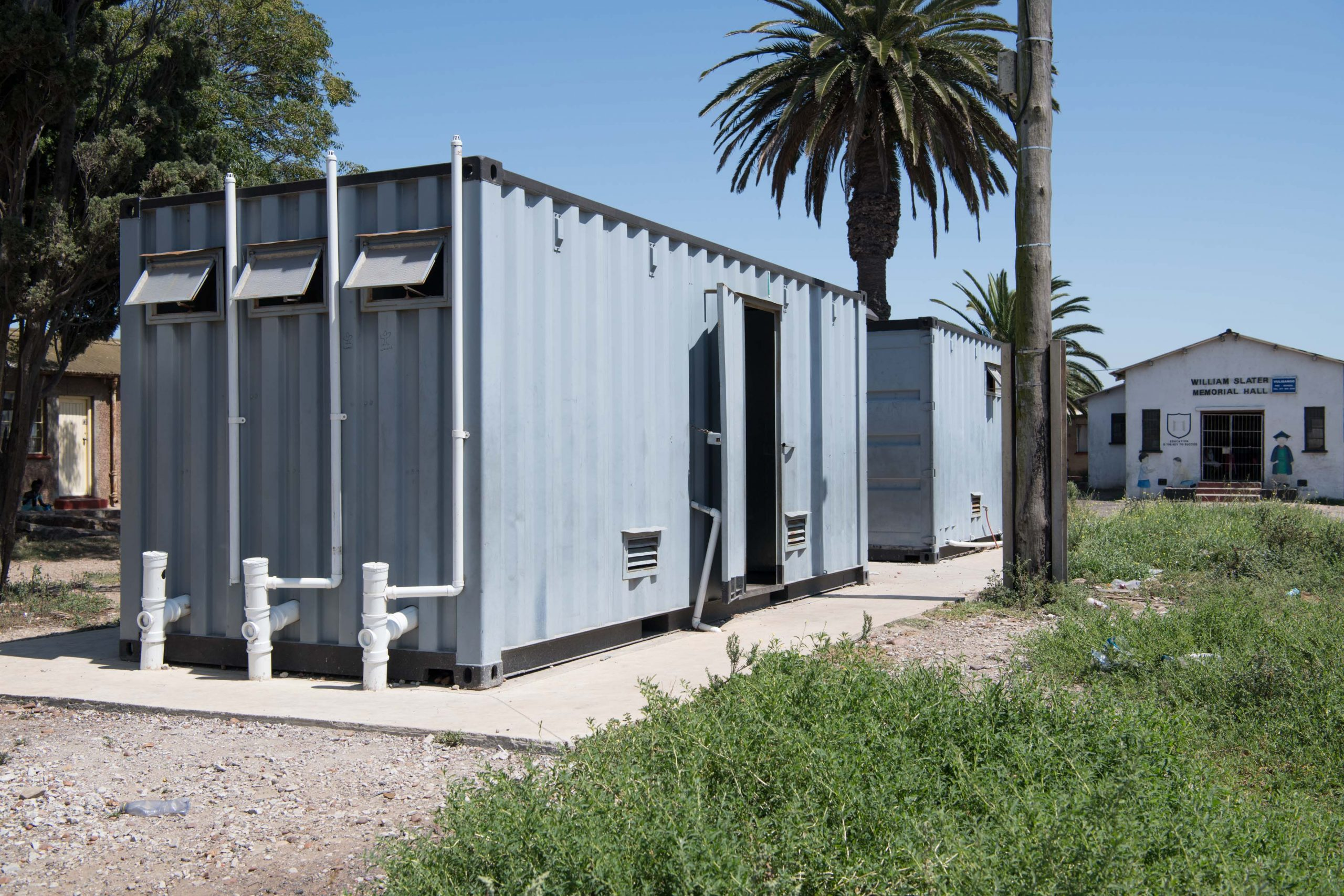 3 February 2020: These containers are meant to be the men's and women's ablution blocks, but only one of them works so everyone has to share the same facilities.