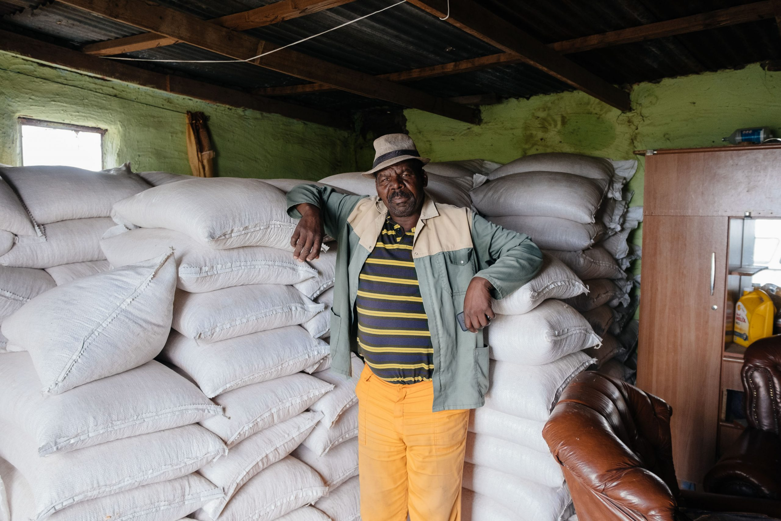 12 December 2019: Lulama Kapa in his grain store. He and his wife Nothandekile Kapa decided against planting crops this year because of uncertainty over the lease for their land.